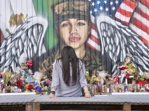 Karina Gonzalez spends a few moments alone at the mural in July to remember Vanessa Guillén. Fort Hood plans to honor the fallen soldier with a memorial gate at the base to be named after her.