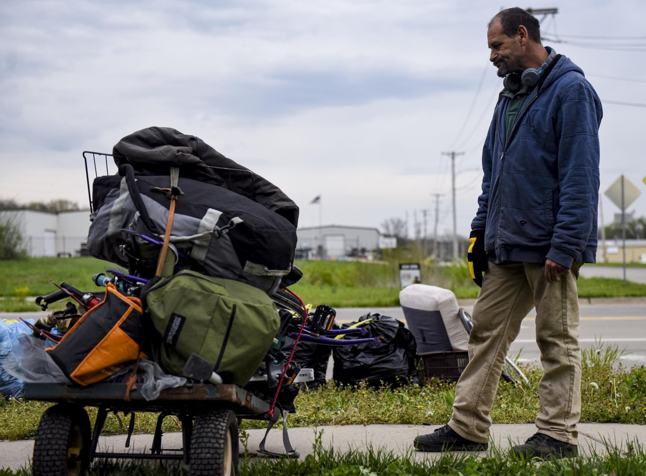 """Bobby Hall looks at a wagon of abandoned items he collected from his friends' old campsite April 11. Hall said he set these items aside to bring back to the family that lived there. """"I like to help where I can,"""" Hall said. """"I think some of this will be really valuable to them."""""""