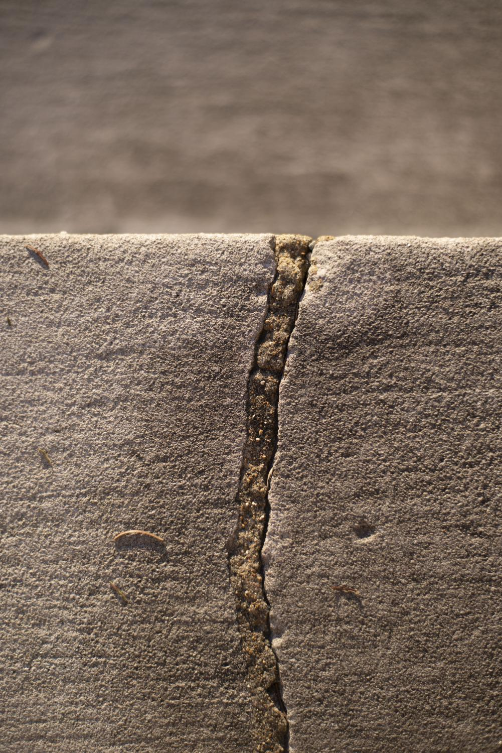 A crack in the concrete is filled with foam Oct. 5 at the University of Missouri in Columbia, Mo.