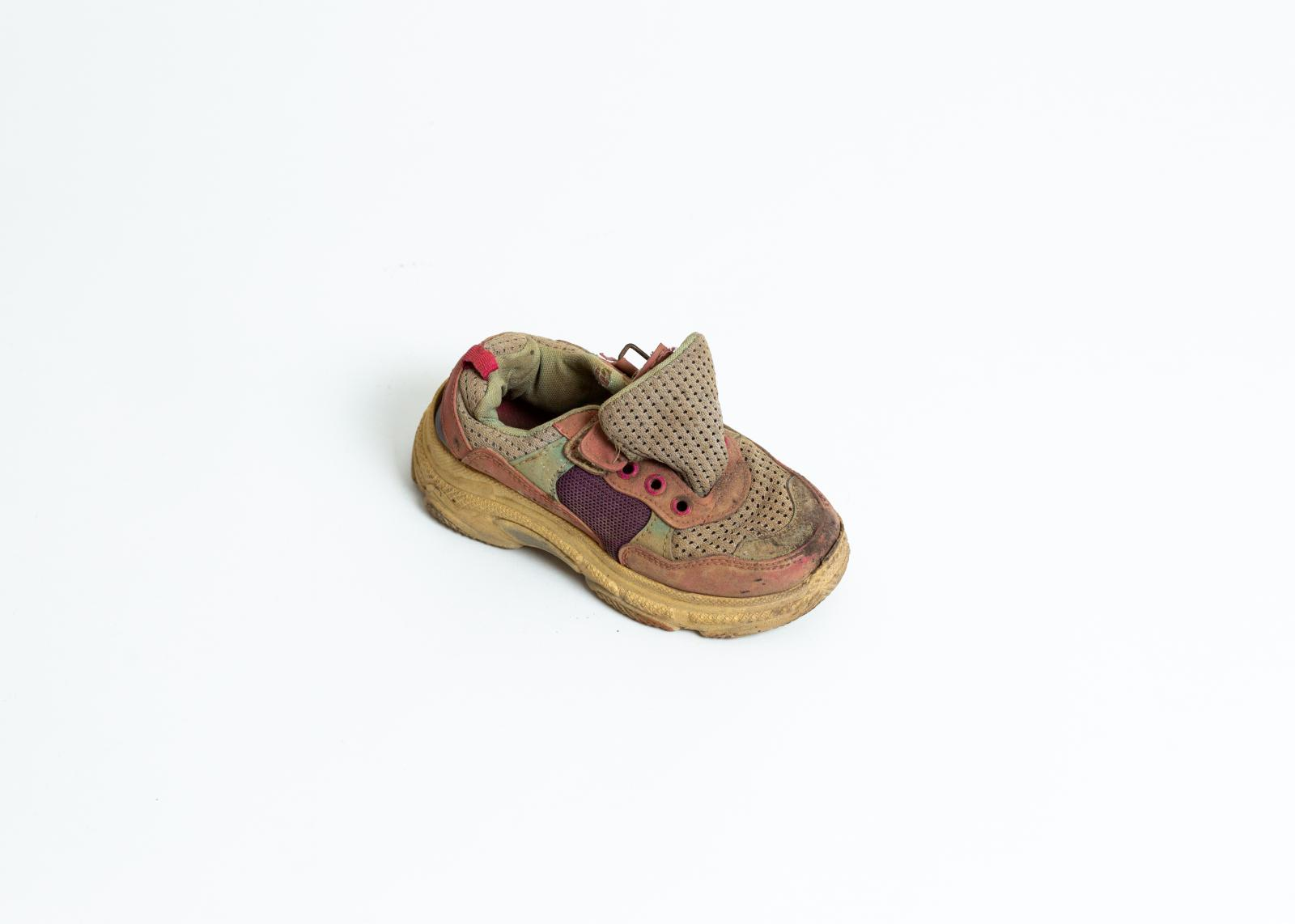 The shoe of a minor. 40% of Morias 13.000 residents are minors, with seven out of ten under the age of twelve. They are particularly vulnerable, many experience mental health issues including self-harm and attempted suicide.