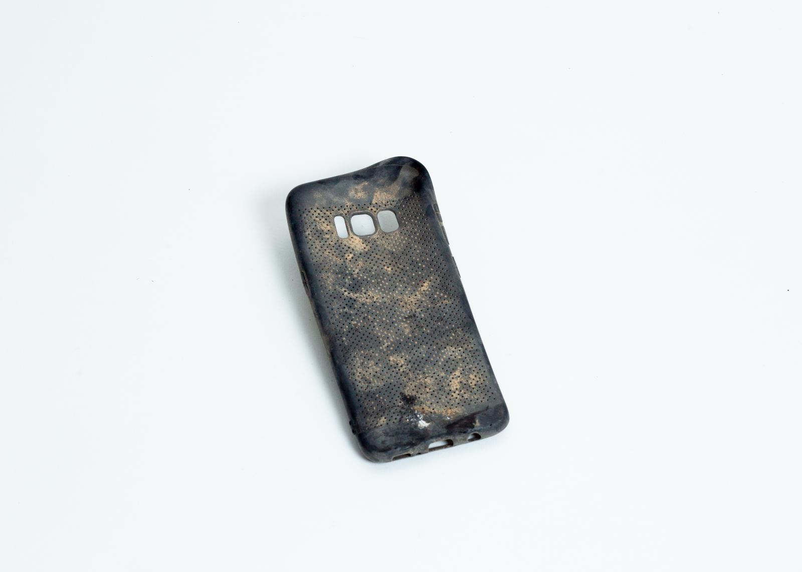 A phone case. The network quality in Moria was low and there was only one Wifi spot, which was often overstrained. For many, however, using their phone was the main activity. Either to keep in contact with friends and family back home or simply to kill time.