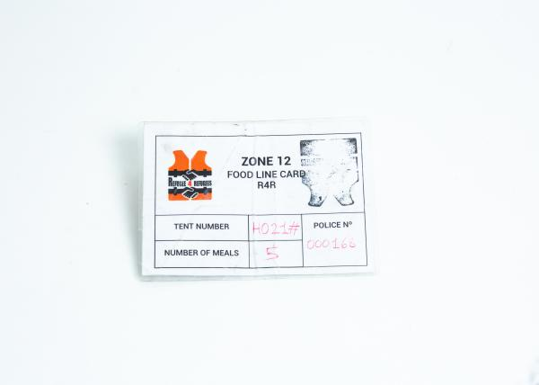 "Food distribution card from the non-governmental organization ""Refugees for Refugees"". Basic services would have collapsed without the support of countless NGO´s. Their role was controversial since some critics state that with their support, they ultimately contribute to the existence of such a place as Moria."