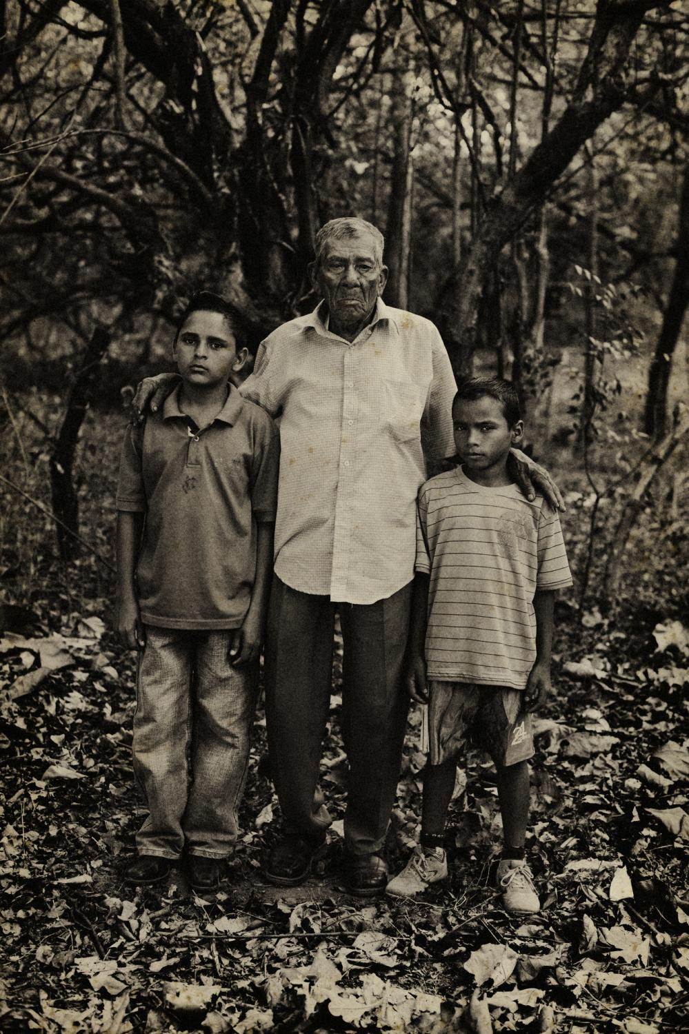Honduras. February 2008. Ermenengildo Ventura Hernandez is the grandfather of Douglas Mauricio Ventura (left) and Walberto Jose Ventura Rios (right) (right), both children are orphans, their parents both died of AIDS.