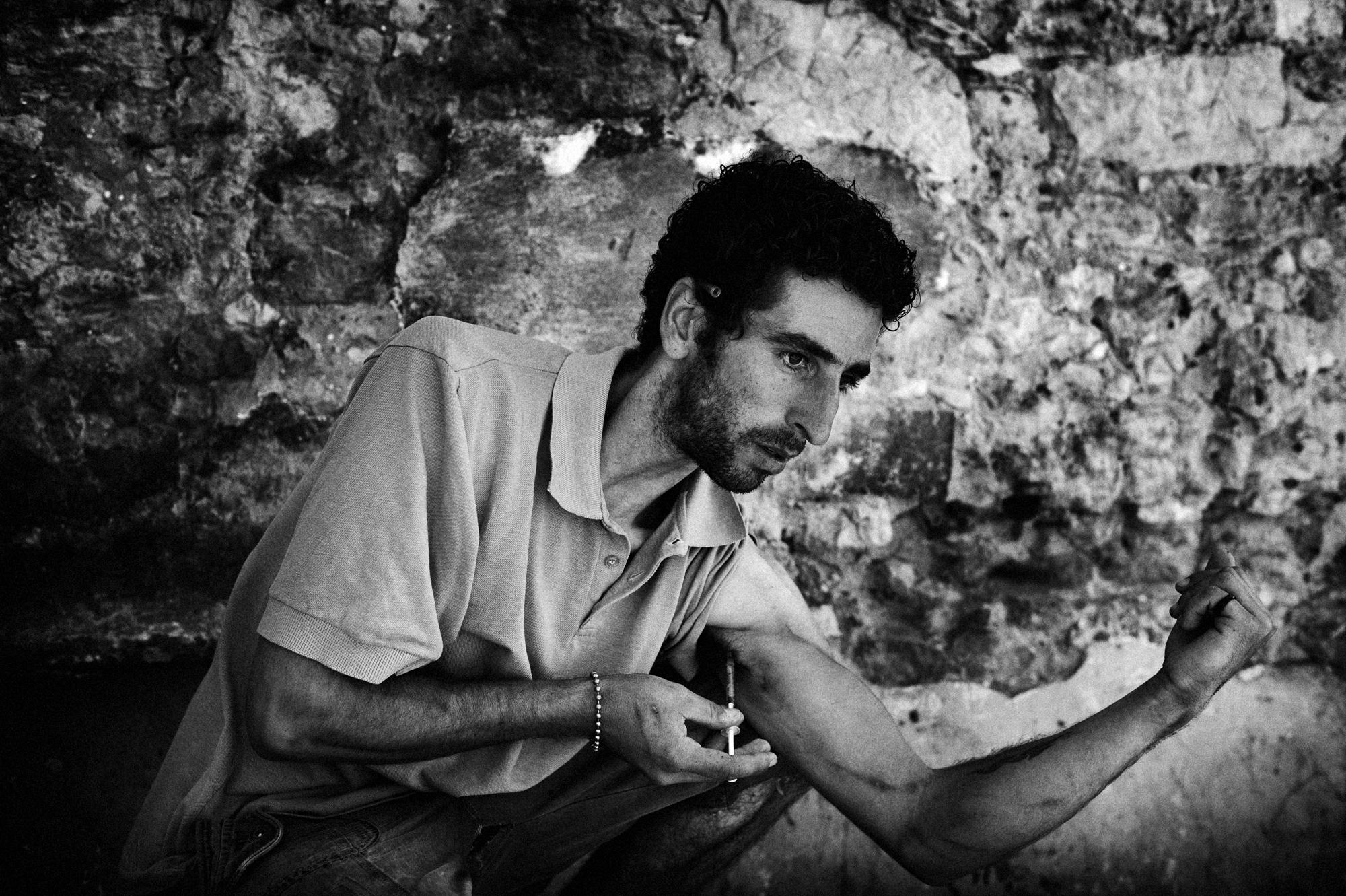 Casal Ventoso, Lisbon, Portugal. July 2011. Paolo, a heroin addict shooting heroin at Casal Ventoso. He is also on a methadone program.