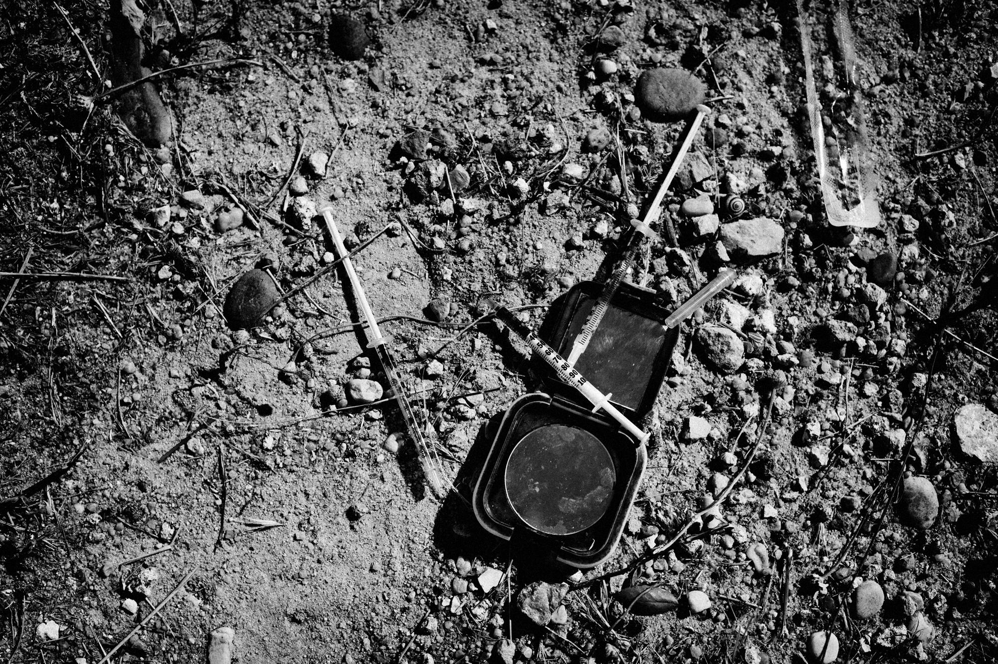Casal Ventoso, Lisbon, Portugal. July 2011. Syringes and needles from Jaime after shooting heroin at Casal Ventoso.