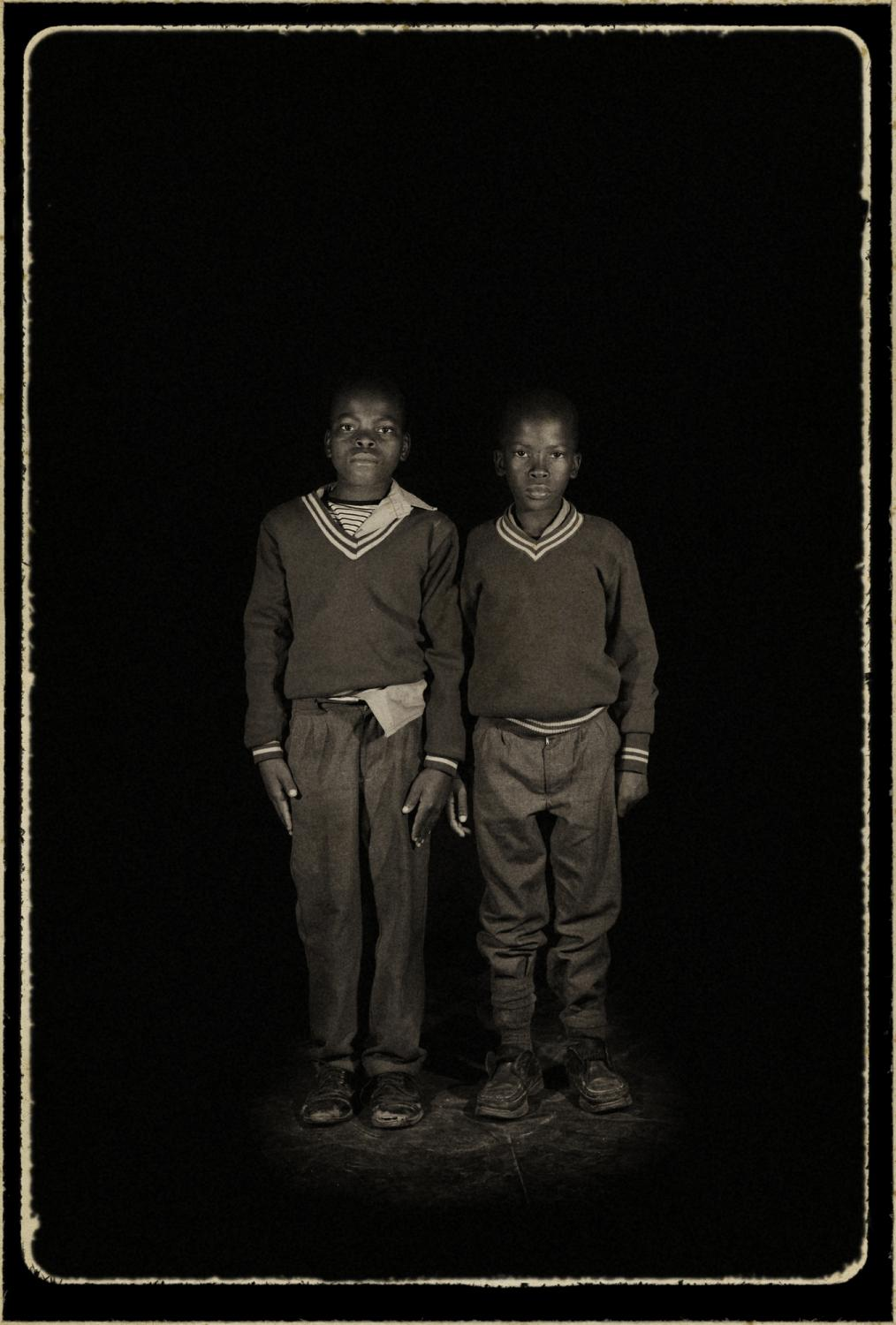 Hosea, Swaziland. ¨Orphans¨ Portrait of orphaned Mbhamali Sibisiso 13 years old, with his brother Mbhamali Bongani 9 years old, they live with their aunt. The HIV/AIDS pandemic has affected almost every family in the Kingdom of Swaziland. The Country has the highest percentage of HIV-positive people in the world, with nearly 36% of those between the ages of 15 and 49 living with HIV. Of extreme concern is the issue of orphans in a Country of just more than one million people an estimated 220,000 people are living with HIV. More than 70,000 children have been orphaned by AIDS. According to UNADIS, the number of orphans will continue to grow at an alarming rate with a projection of 120,000 orphans in the Country by 2010. (UNAIDS: 2006 Report on the global AIDS epidemic).
