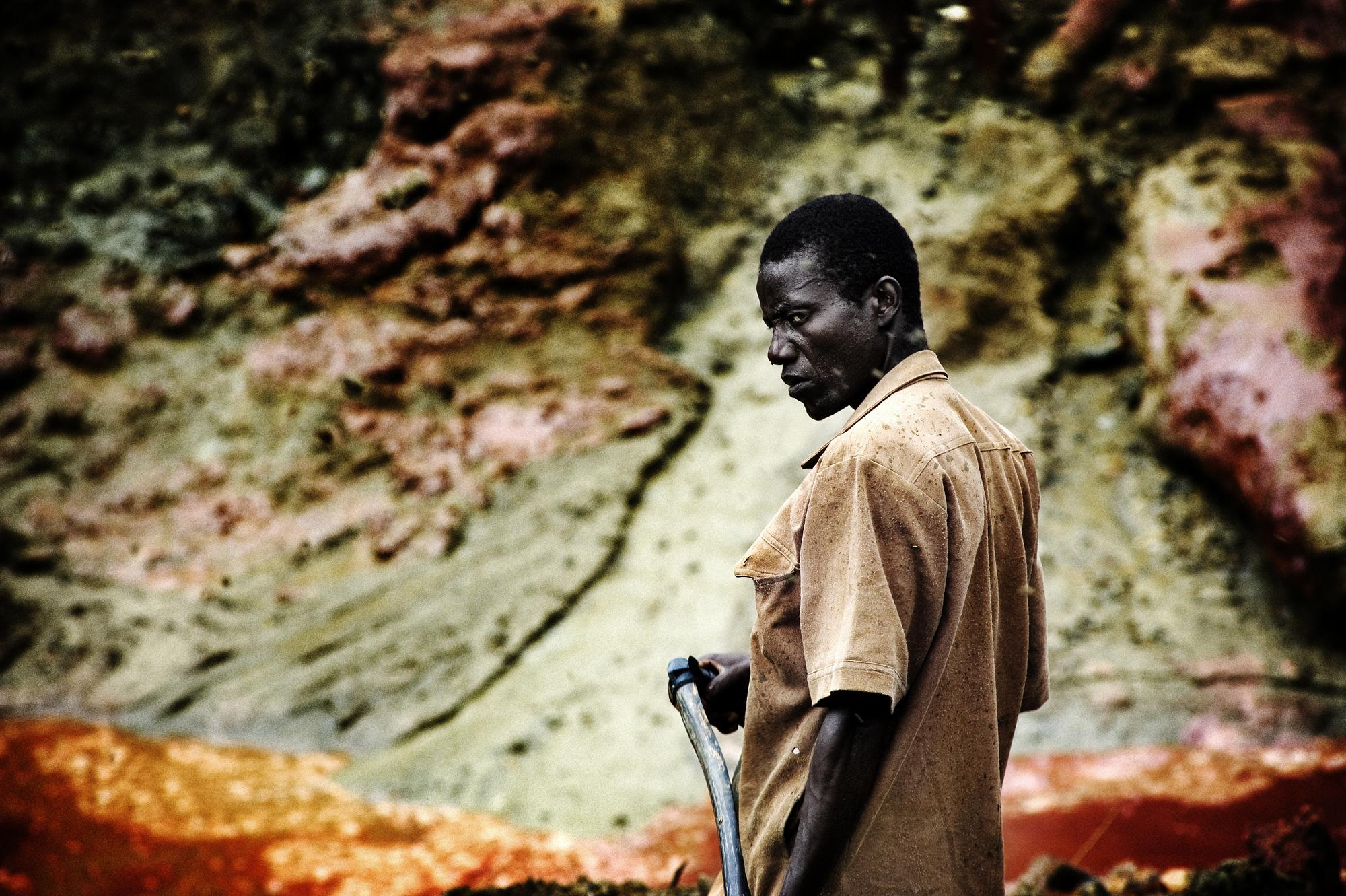 Sierra Leone, Koidu. August 2008. Diamond diggers working at the mine. Over the last three decades, Sierra Leone has suffered from conspicuously constrained economic growth. In spite of this negative development, the mining sector is believed to be the only sector that can easily contribute significantly to the country's economic recovery and development process. The mining sector in Sierra Leone of which diamonds play a central role, was no doubt, the economic nerve center for the growth and development of the country in the 1960s and 1970s. It was a major source of revenue for the government and its proper management had a significant implication in the economic, social and even political life of the people of Sierra Leone. With bad politics, poor management and downward economic trends, the diamond sector became mismanaged, uncoordinated; illegality prevailed and eventually collapsed. The 11-year brutal rebel war (1991-2002) was partly a result of this unfortunate situation that ended up drilling the last nail in the death coffin of the mining sector.