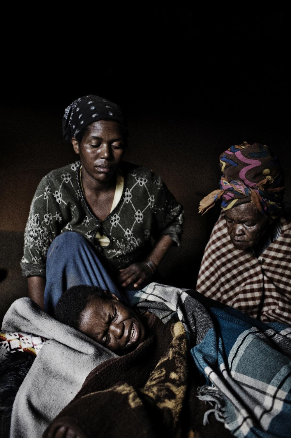Lesotho. Matseliso Makhaleme is lying on the floor suffering from multi-drug resistant tuberculosis (MDR-TB) and HIV, she is under ART treatment. Here her sister and mother are taking care of her. Lesotho is a mountainous country located entirely within the borders of South Africa. It is home to more than 2 million people and has one of the highest HIV burdens in the world, with between 23 and 30% of the population estimated to be infected with the disease (UNAIDS 2004). Lesotho is also burdened by a high rate of TB, with an incidence of 465 per 100,000 population reported in 2005 (10,363 cases), making it the country with the fourth highest incidence in the world. Lesotho is likely in the midst of a public health disaster, where a drug-resistant TB epidemic and HIV epidemic are colliding, one fueling the other. An estimated 950 new MDR-TB patients will be diagnosed every year in Lesotho.