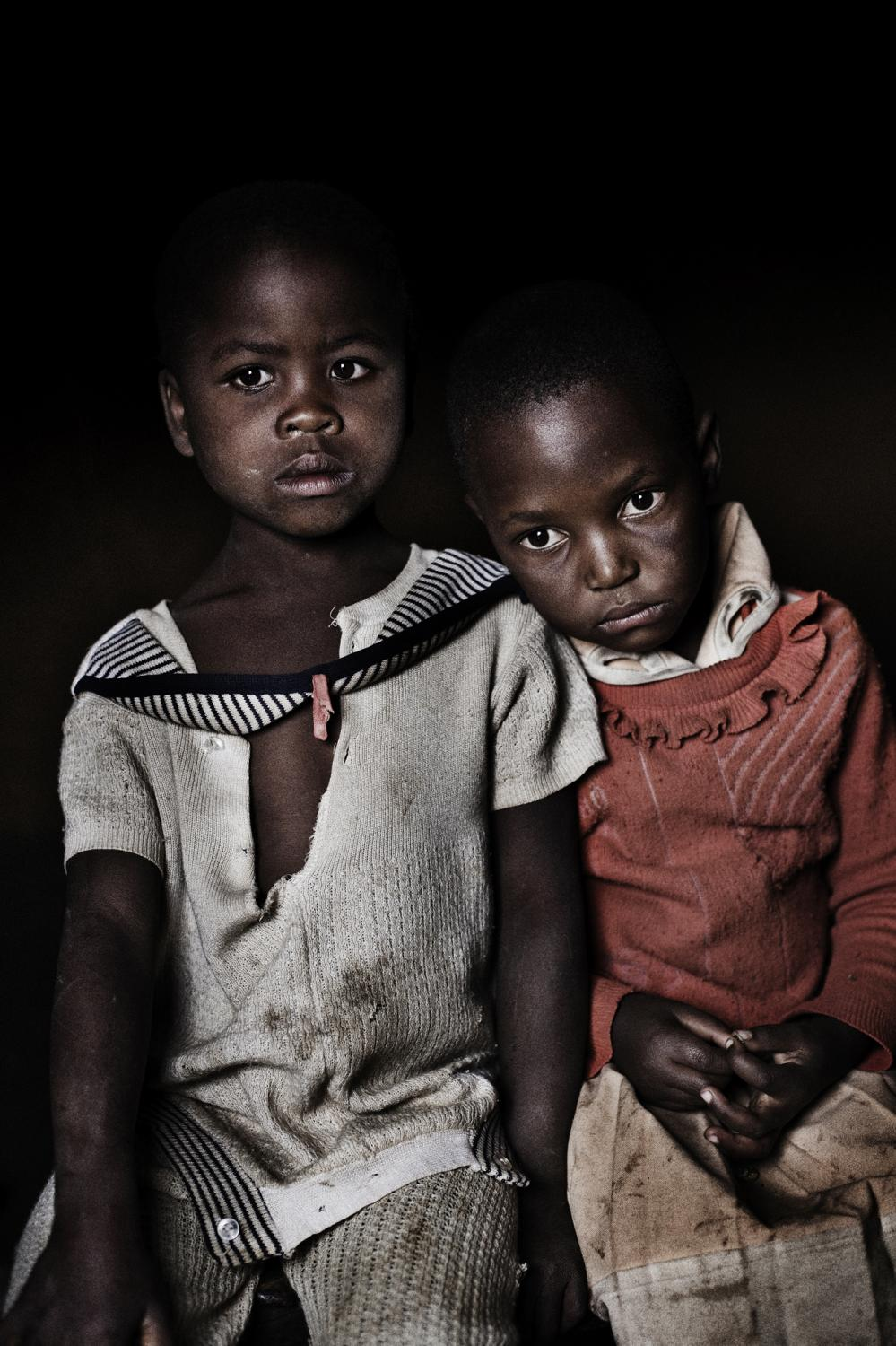 Lesotho. Portrait of Pulane Makhaleme and Hopolang Makhaleme, the two daughters of Matseliso Makhaleme who is suffering from multi-drug resistant tuberculosis (MDR-TB) and HIV, she is under ART treatment. Lesotho is a mountainous country located entirely within the borders of South Africa. It is home to more than 2 million people and has one of the highest HIV burdens in the world, with between 23 and 30% of the population estimated to be infected with the disease (UNAIDS 2004). Lesotho is also burdened by a high rate of TB, with an incidence of 465 per 100,000 population reported in 2005 (10,363 cases), making it the country with the fourth highest incidence in the world. Lesotho is likely in the midst of a public health disaster, where a drug-resistant TB epidemic and HIV epidemic are colliding, one fueling the other. An estimated 950 new MDR-TB patients will be diagnosed every year in Lesotho.