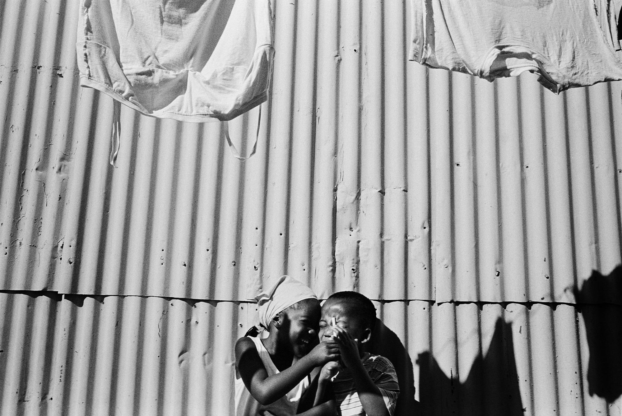 SOUTH AFRICA Khayelitsha Township, Cape Town Luniko plays with his friend at home. The two children are both HIV positive and are being treated with antiretroviral (ARV) therapy.