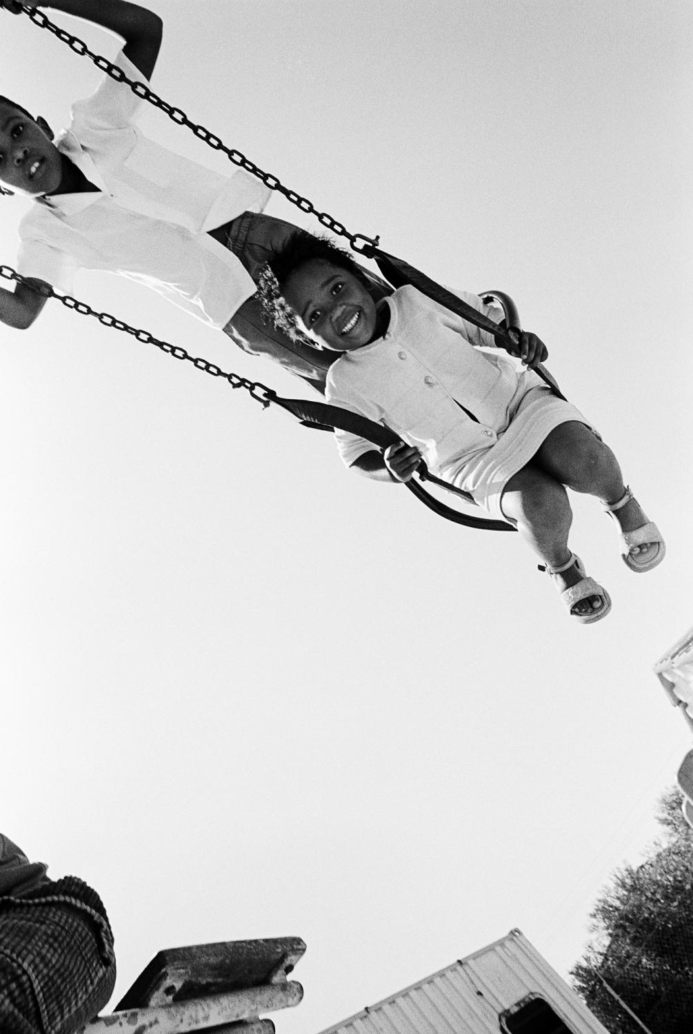 SOUTH AFRICA Khayelitsha Township, Cape Town HIV positive children play on a swing at 'Lizo Nobanda' day care centre. Here children orphaned after the deaths of their parents from AIDS, learn how to read and write, play together and eventually accept their HIV positive status.