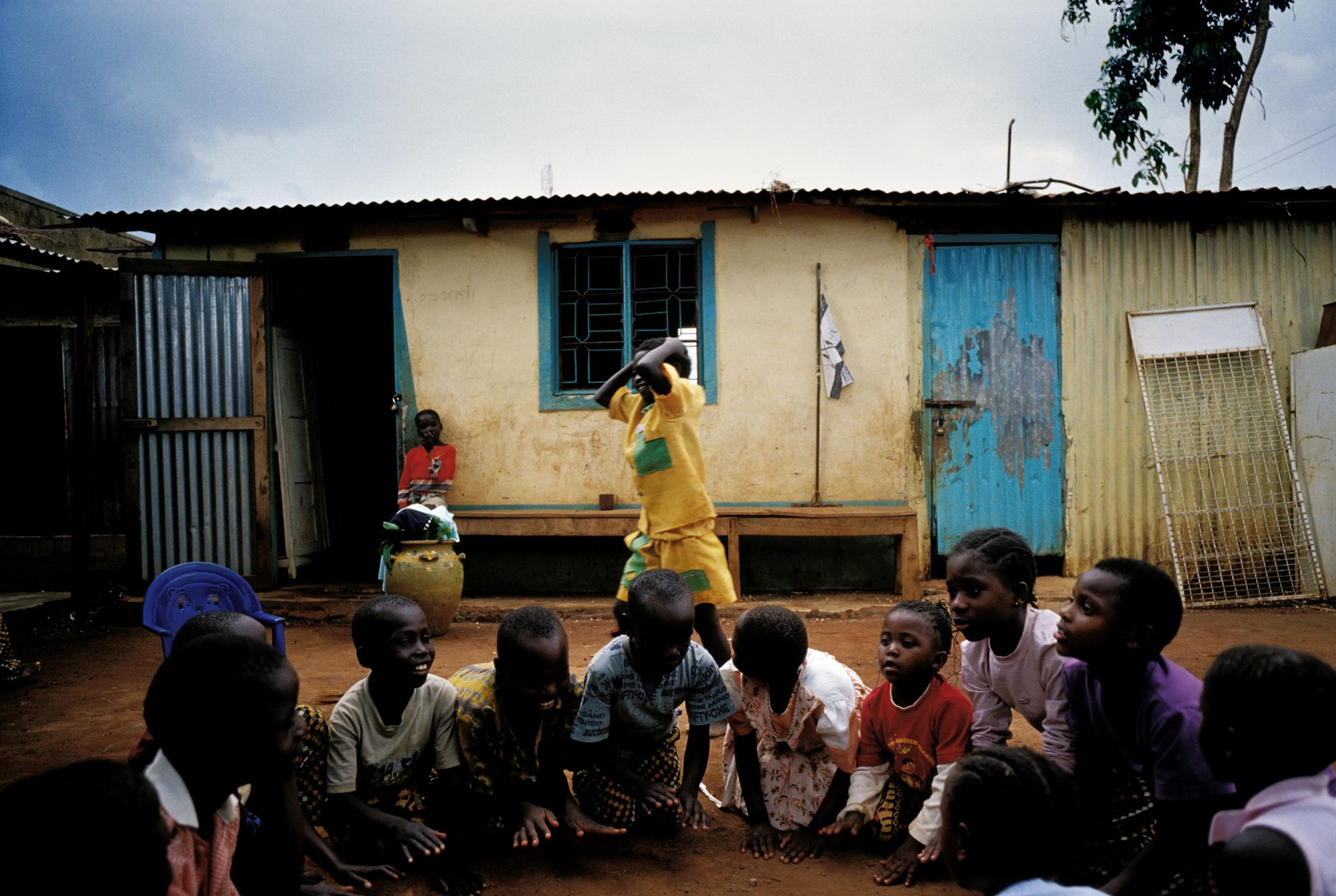 KENYA Busia Children playing at Busia orphanage. Some of the children, including Anaklete (standing, in yellow), are HIV positive and receive antiretroviral (ARV) drugs as part of a project run by Medecins Sans Frontieres (MSF) in collaboration with the Ministry of Health.