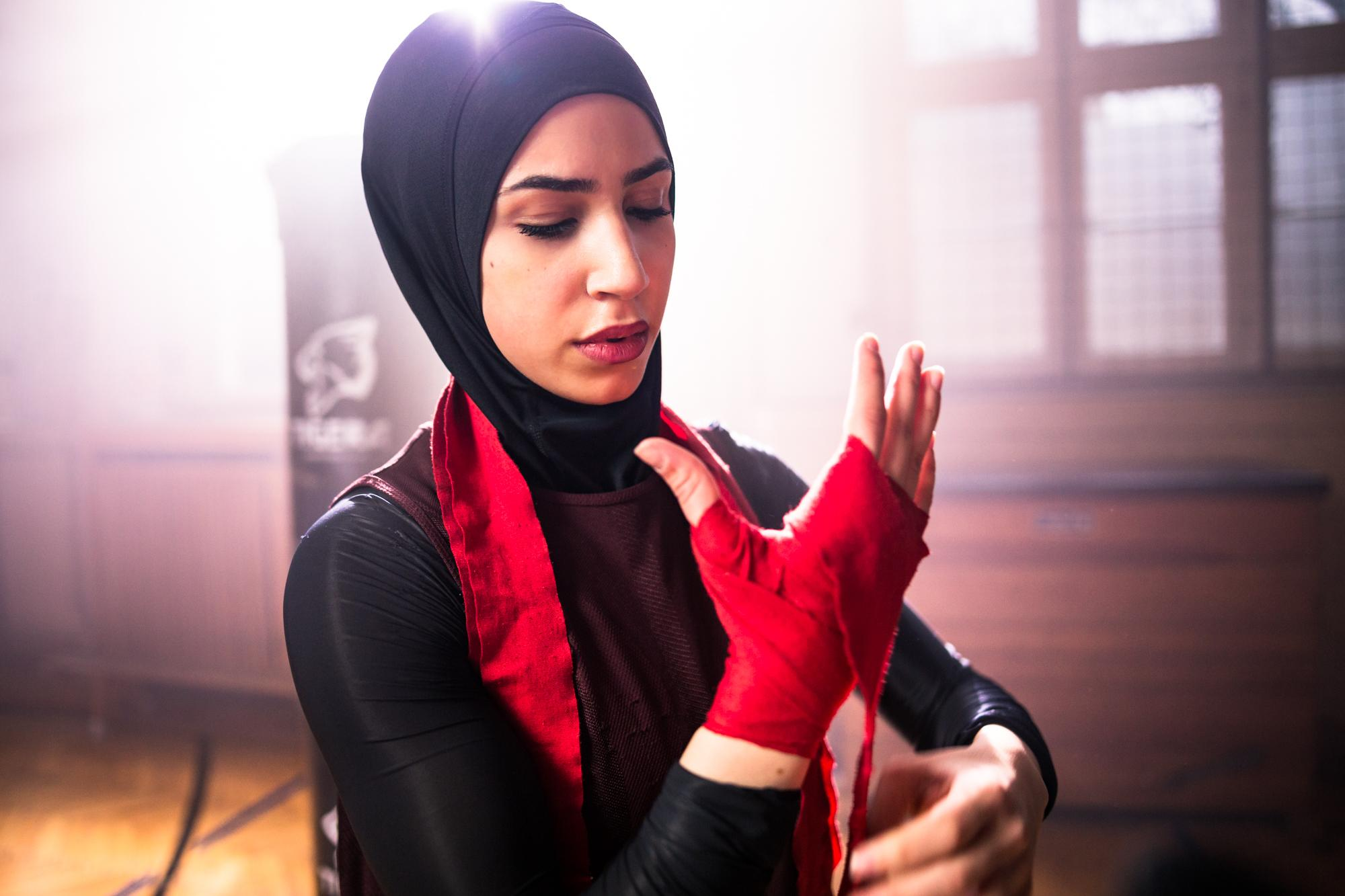Zeina Nassar, 21, German box champion poses for a portrait inside her first boxing gym.