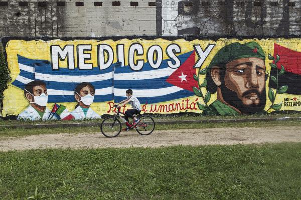 Parco Dora, Turin, Italy. Murales in honor of Cuba and their doctors and nurses who came in Turin to fight Covid19. With the outbreak of the epidemic within two months, Cuba involved 2,900 doctors in 22 countries, first of all to north of Italy. This was the first time they were needed in Europe.