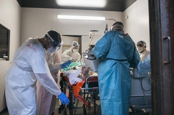 Cuban doctors preparing a patient that needed to be translated to another hospital for some specific analysis