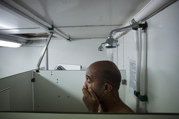 Abel Tobìas having a shower after his shift into the red zone. He was one of the most relevant doctors of the Brigade, he worked no stop every day.
