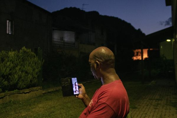 Val di Susa, Italy. Doc Abel Tobìas speaking by phone with his wife in Santiago di Cuba. She is a doctor as well and offers to him a constant emotional support on distance during his missions.