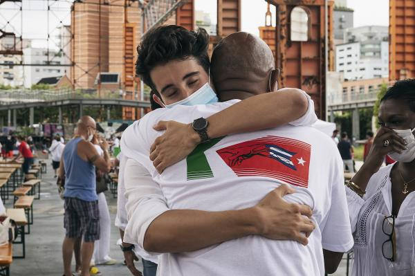Parco Dora, Turin, Italy. Umberto, a young doctor of the OGR, greets and thanks the cuban doctor Abel Tobías, during the party organized to celebrate the healed by Covid-19 at the Ogr and the work of the Cuban Brigade that is going to return home.