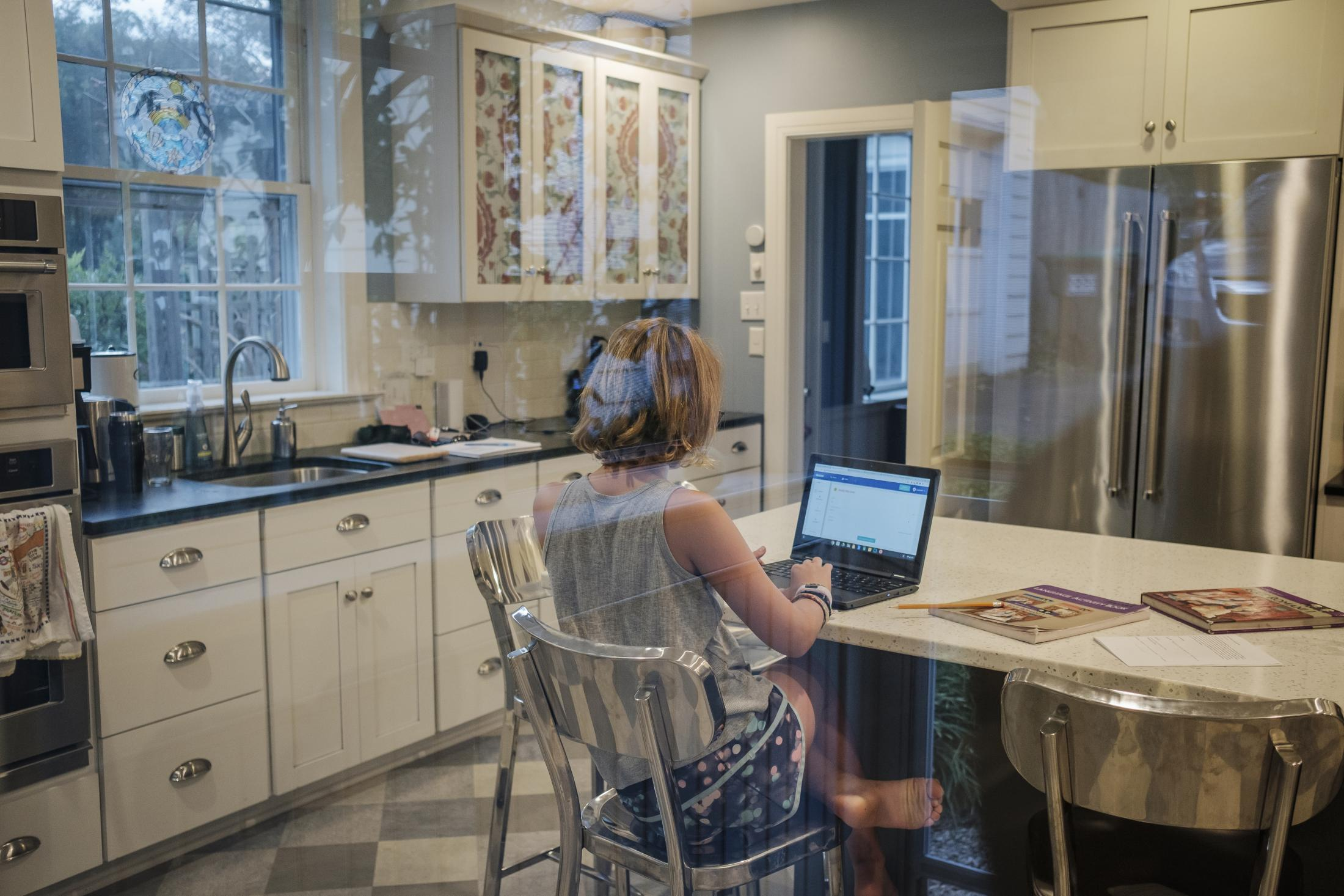 Hannah Seidman working on her science homework at her house in Charlottesville, Virginia, U.S., on Monday Sept. 23, 2019. Hannah is a patient in a genetic risk study about type 1 diabetes at University of Virginia. Photographer: Carlos Bernate/ NPR