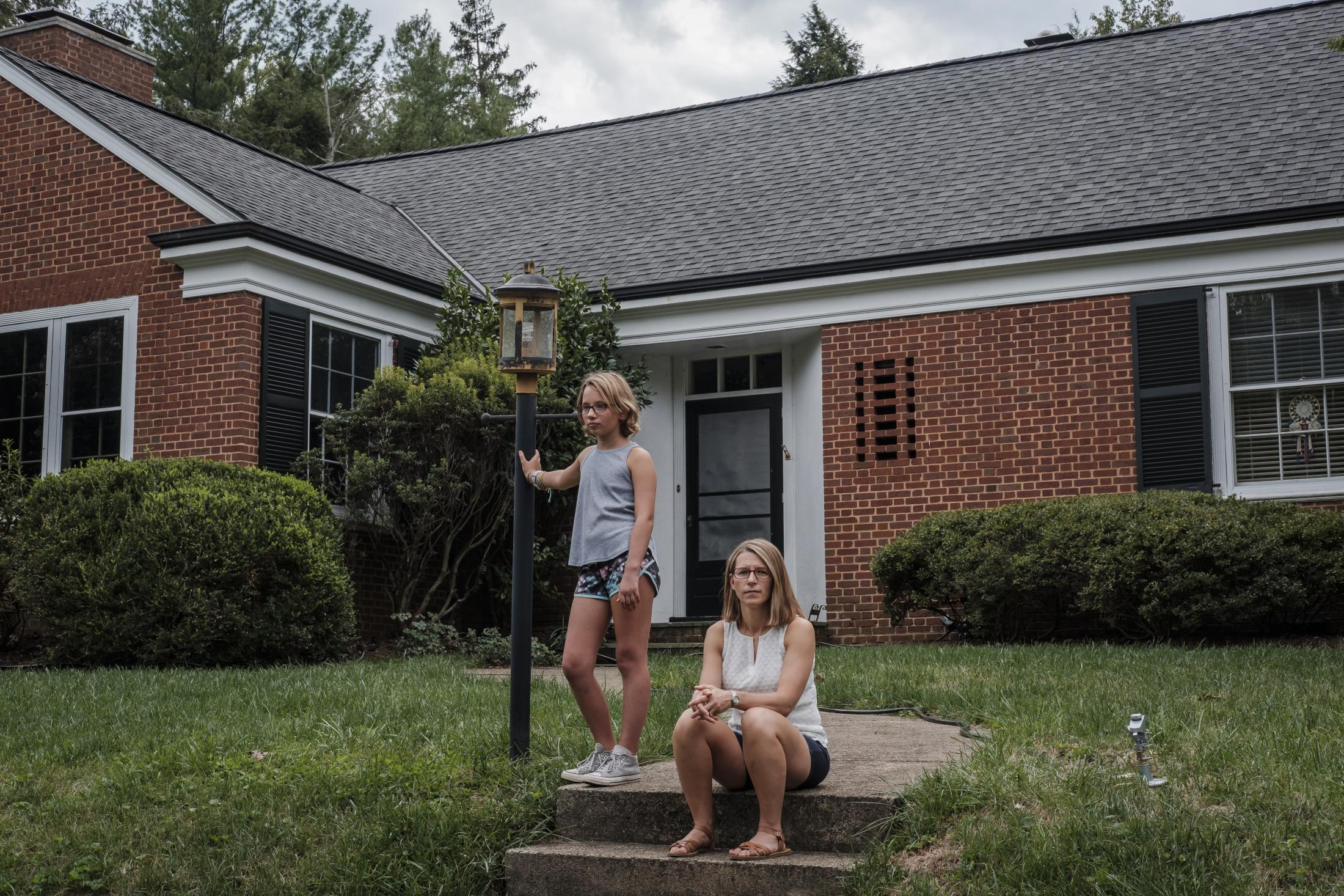 Jeri Seidman and her daughter Hannah pose for a portrait at their house in Charlottesville, Virginia, U.S., on Monday Sept. 23, 2019. Hannah is a patient in a genetic risk study about type 1 diabetes at University of Virginia. Photographer: Carlos Bernate/ NPR