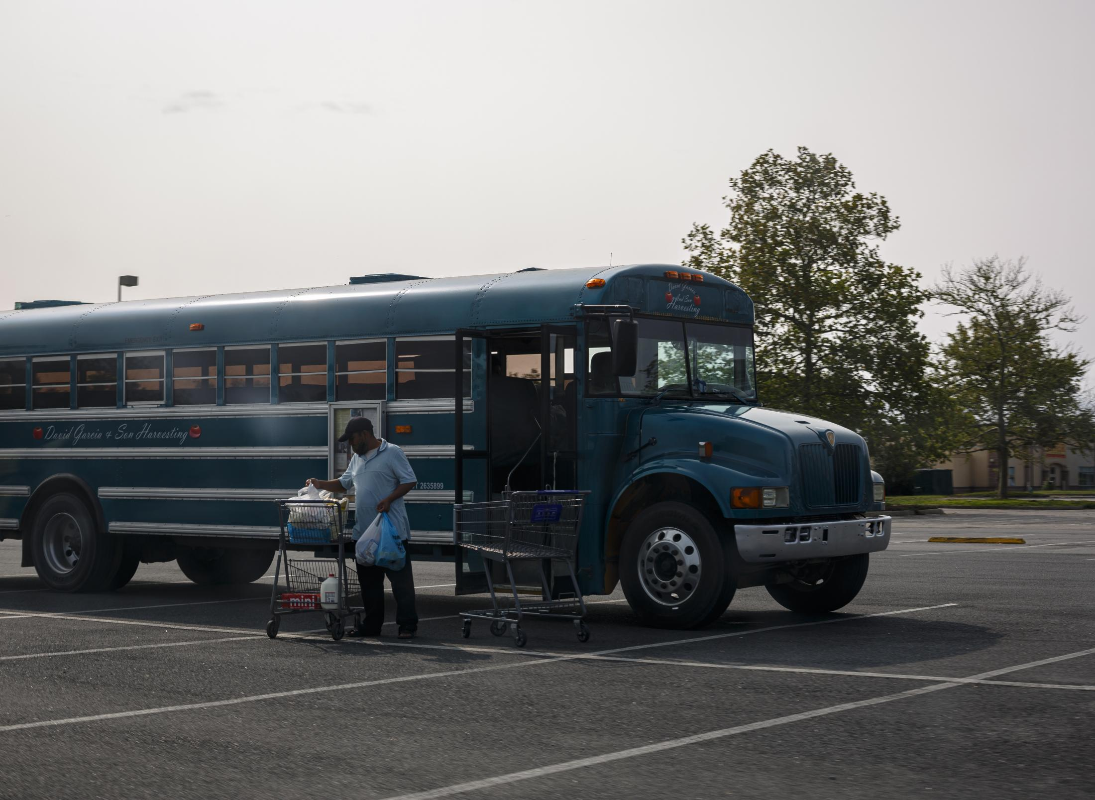 CHERITON, VA – September 9, 2020: Seasonal farmworkers being brought in buses from the barracks where they live to the Food Lion at Cape Charles, VA to buy groceries. Seasonal farmworkers are brought by the thousands to toil in the tomato fields, since the start of the covid-19 pandemic, their conditions have worsened. Photo: Carlos Bernate for The New York Times