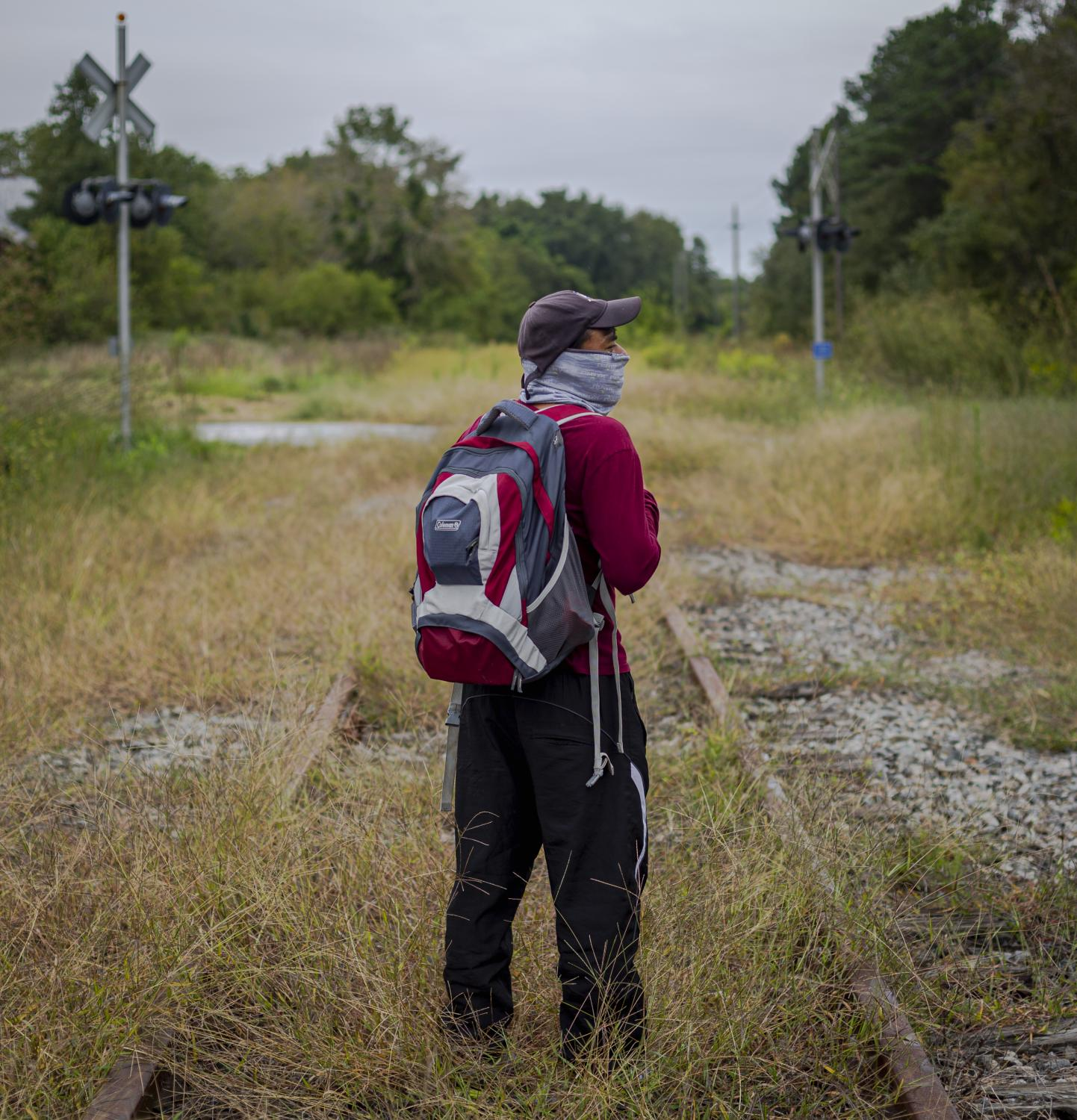 CHERITON, VA – September 26, 2020: Seasonal farmworker poses for a portrait on the abandoned train tracks that they walk to get to one of the two Latino stores in town. Seasonal farmworkers are brought by the thousands to toil in the tomato fields, since the start of the covid-19 pandemic, their conditions have worsened. Photo: Carlos Bernate for The New York Times