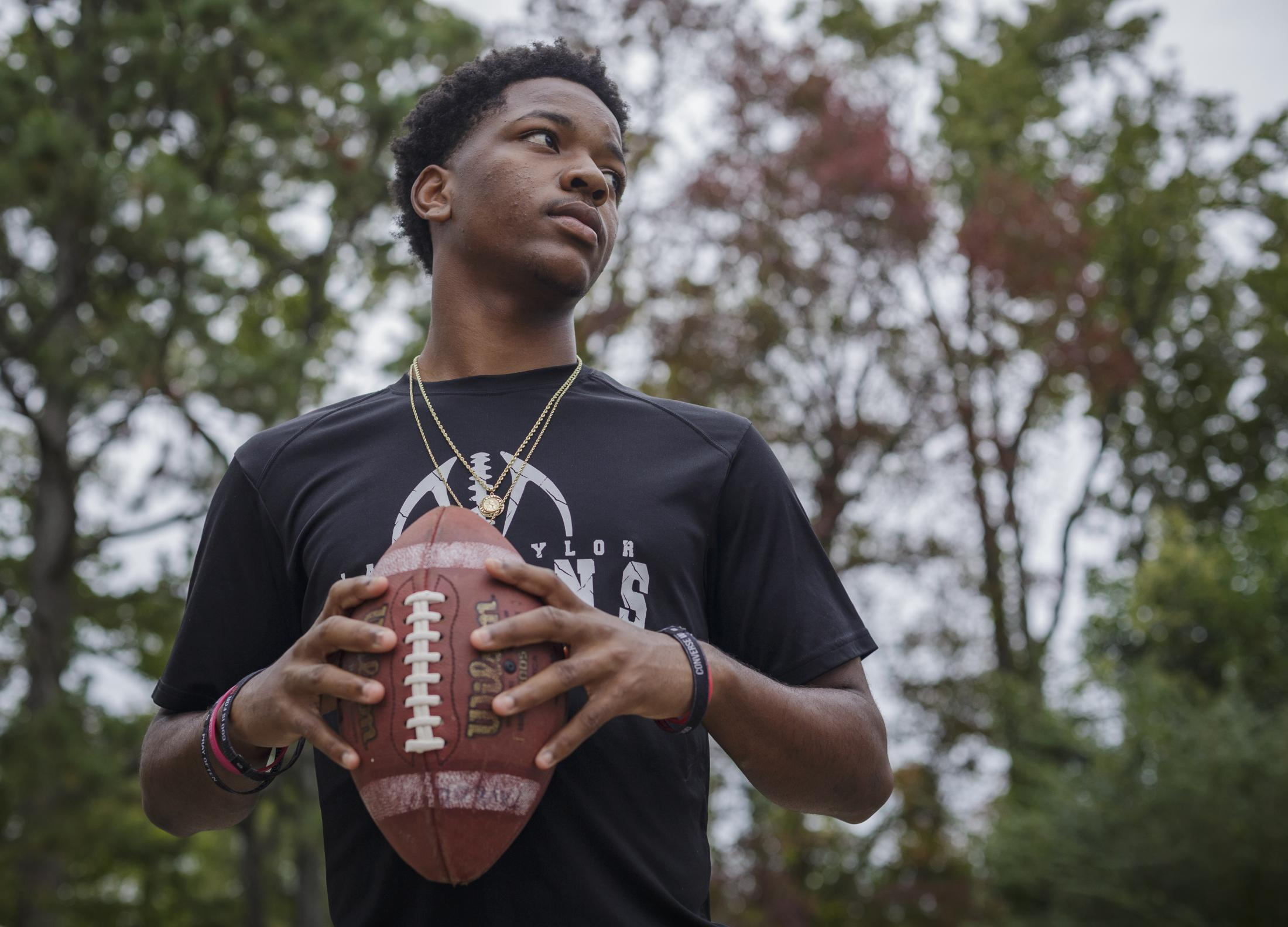 NORFOLK, VA – October 29, 2020: Pierre Royster, a member of the Lake Taylor High School TITANS, poses for a portrait outside his house. Due to the COVID-19 pandemic, football games were canceled at Lake Taylor High School in Norfolk, VA, leaving the TITANS members with plenty of free time. Carlos Bernate / The Undefeated
