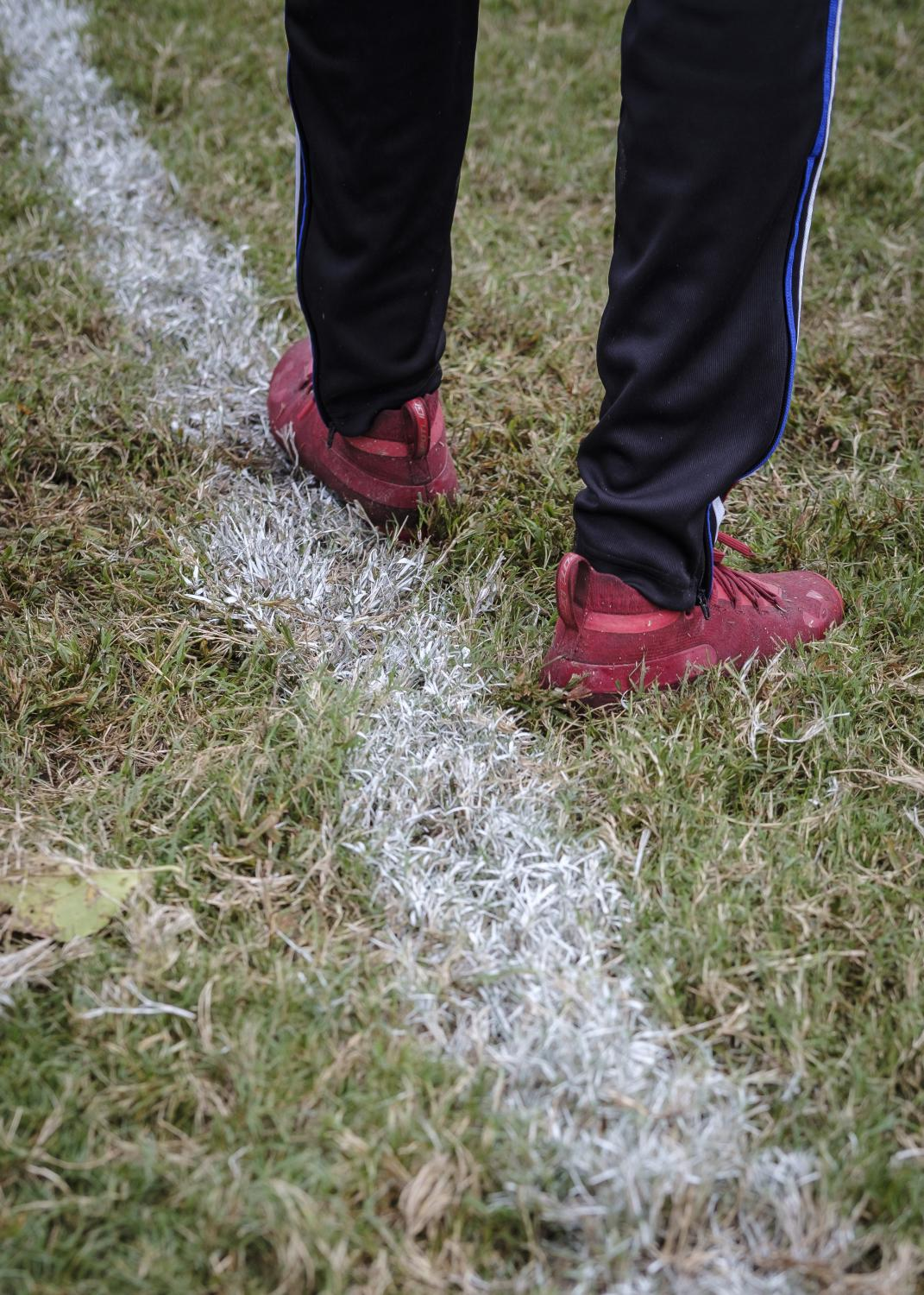 NORFOLK, VA – October 29, 2020: Jeff Foster detail of his cleats during football practice. Jeff is a member of the Lake Taylor High School TITANS. Due to the COVID-19 pandemic, football games were canceled at Lake Taylor High School in Norfolk, VA, but weekly practice are still going on. Carlos Bernate / The Undefeated