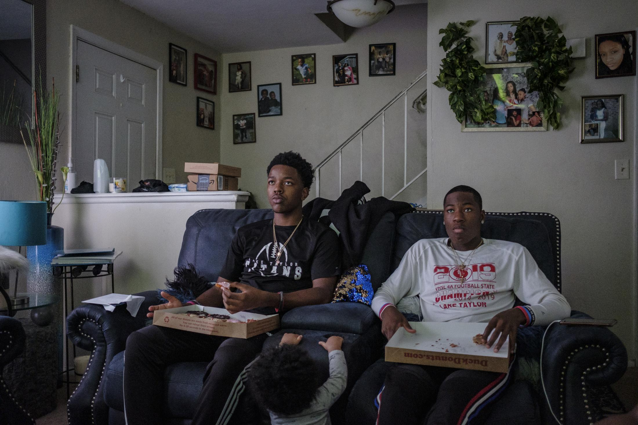 NORFOLK, VA – October 29, 2020: Pierre Royster and Jeff Foster, members of the Lake Taylor High School TITANS, at Pierre's home eating and playing video games. Due to the COVID-19 pandemic, football games were canceled at Lake Taylor High School in Norfolk, VA, leaving the TITANS members with plenty of free time. Carlos Bernate / The Undefeated