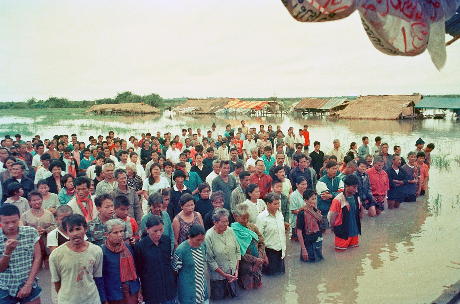 Community members fighting against the Rasi Salai Dam stand in Mae Mun Man Yuen 2 protest village as it is slowly flooded in 1992. This protest village was constructed on the flood plains of the dam and was their way to attempt to demand the flood gates remain open. The authorities refused, kept the gates closed, causing this protest site to become submerged. Photo courtesy of the Wetland People Association - Rasi Salai, Si Saket.