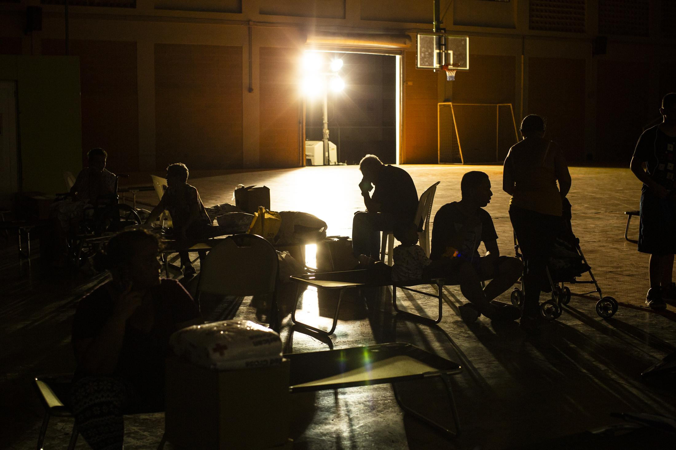 """People take shelter at the Coliseo Mariano """"Tito"""" Rodriguez in Guánica, P.R., on January 6, 2020. After a 5.8 earthquake hit the south of the island in the early morning multiple homes were damaged near the epicenter. The area has been active since Dec. 28, 2019 and replicas have continued to be felt.(Erika P. Rodriguez for The New York Times)"""