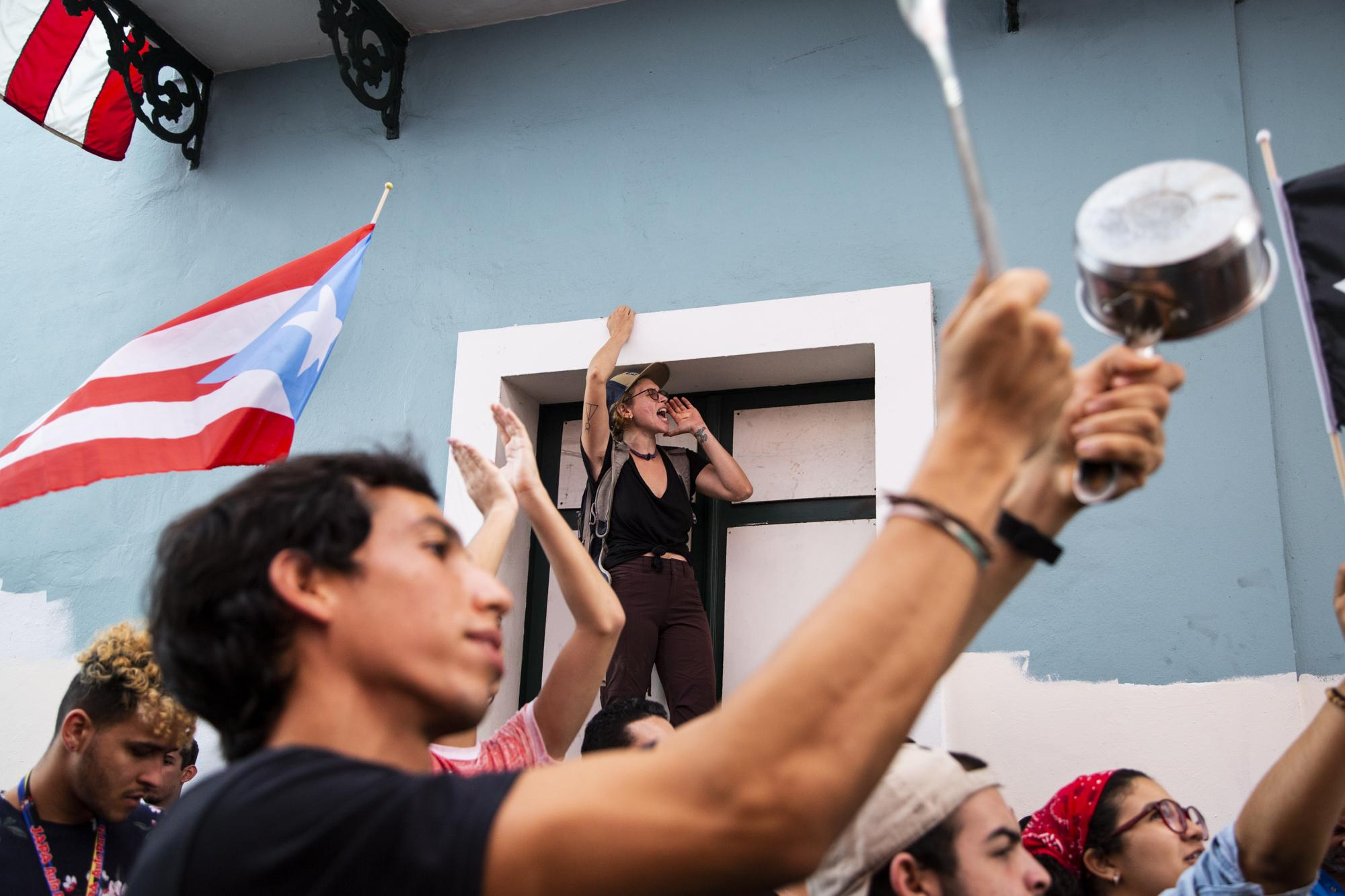 People gather to protest outside the governor's mansion in San Juan, P.R., on Jan. 20, 2020. On Saturday a storage with aid from hurricane Maria was found with undistributed supplies in Ponce, an area affected by the recent earthquakes. (Erika P. Rodriguez for The New York Times)