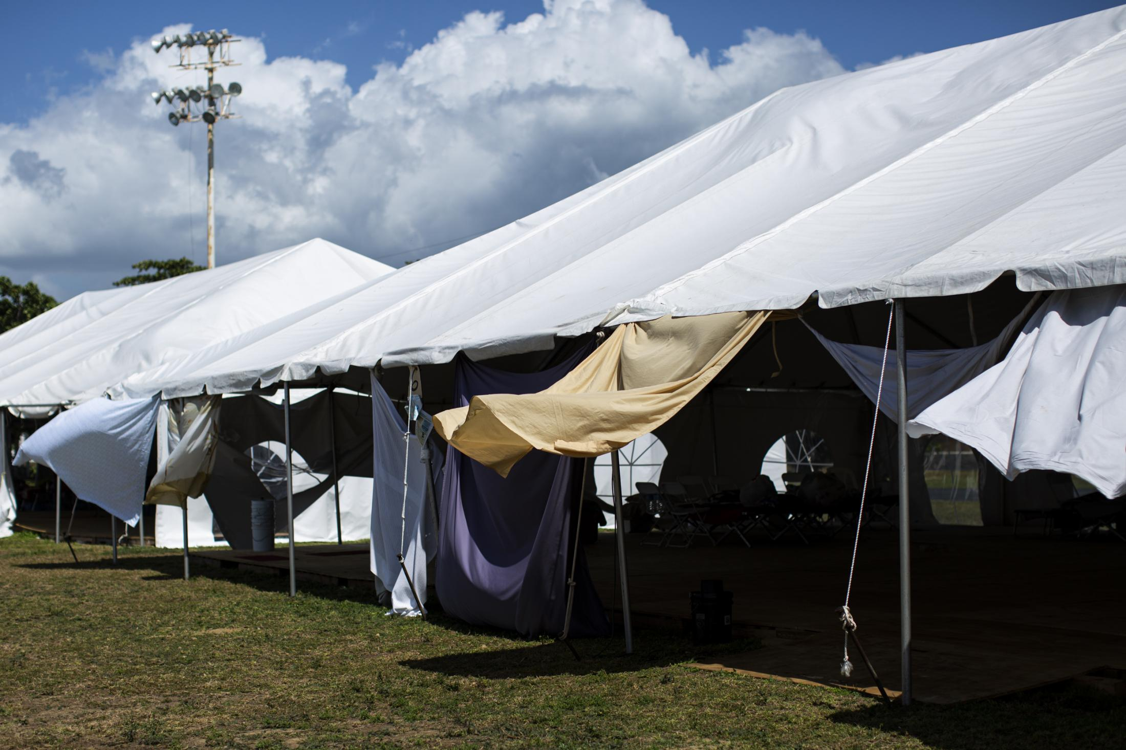 Tents used to house people at the government shelter in the town's athletics track on February 12, 2020, in Guanica, P.R. There are 172 people at the shelter. After a cluster of earthquakes ravaged the south of the island last month 800 people are still living in government shelters and makeshift camps. Hundreds are thought to be camping in their backyards In fear of having their homes collapse if another mayor quake hits. On January 7 the strongest earthquake hit at a 6.4 magnitude. (Erika P. Rodriguez for The New York Times)