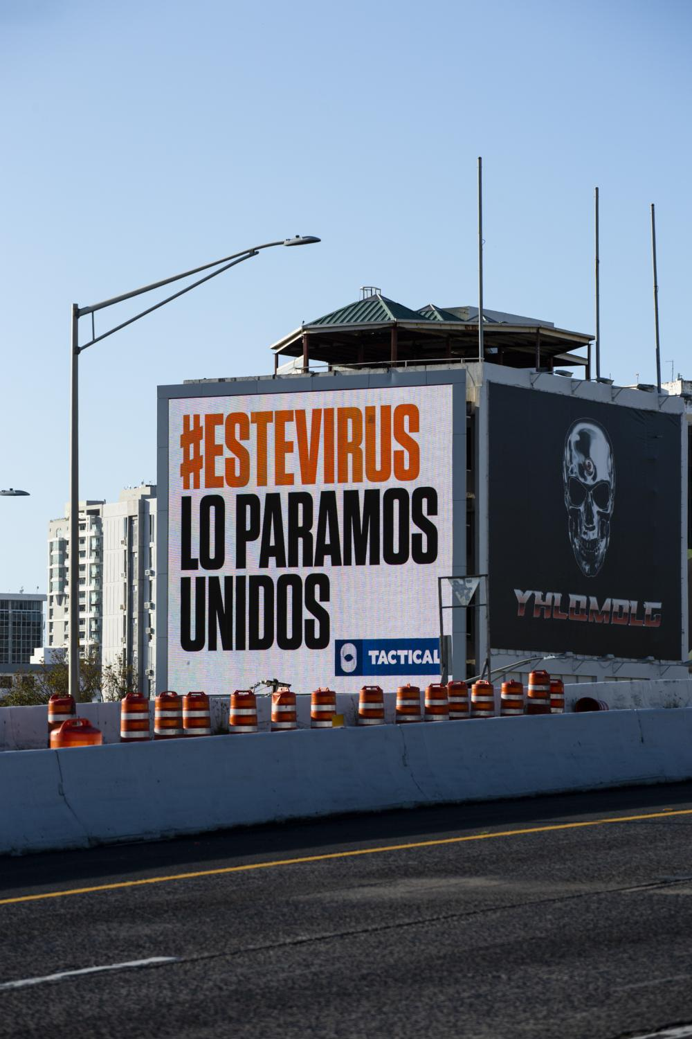 A billboard seen form the highway in Santurce displays the message 'we stop this virus together' (este virus lo paramos unidos) on April 19, 2020, in San Juan, P.R. The island has been under lockdown for COVID-19 since March 15 under some of the strictest measures in the U.S. territory, and has the lowest amount of testing per capita. (Erika P. Rodriguez for The New York Times)