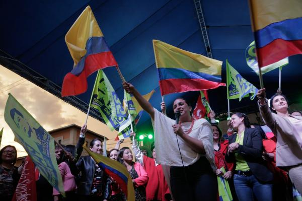 Gabriela Rivadeneira, president of the National Assembly of Ecuador, along with other legislators, waves an Ecuadorian flag outside the Assembly in an act in support of the pro-government party on the afternoon of December 3, 2015. Quito, Ecuador.