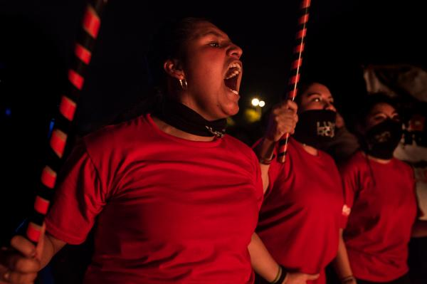 """Member of the women's self-defense group called Valkirias is par of an act of protest against Gender based violence in the park """"El Arbolito"""" on the night of November 25, 2017, international day for the elimination of violence against women. Quito, Ecuador."""