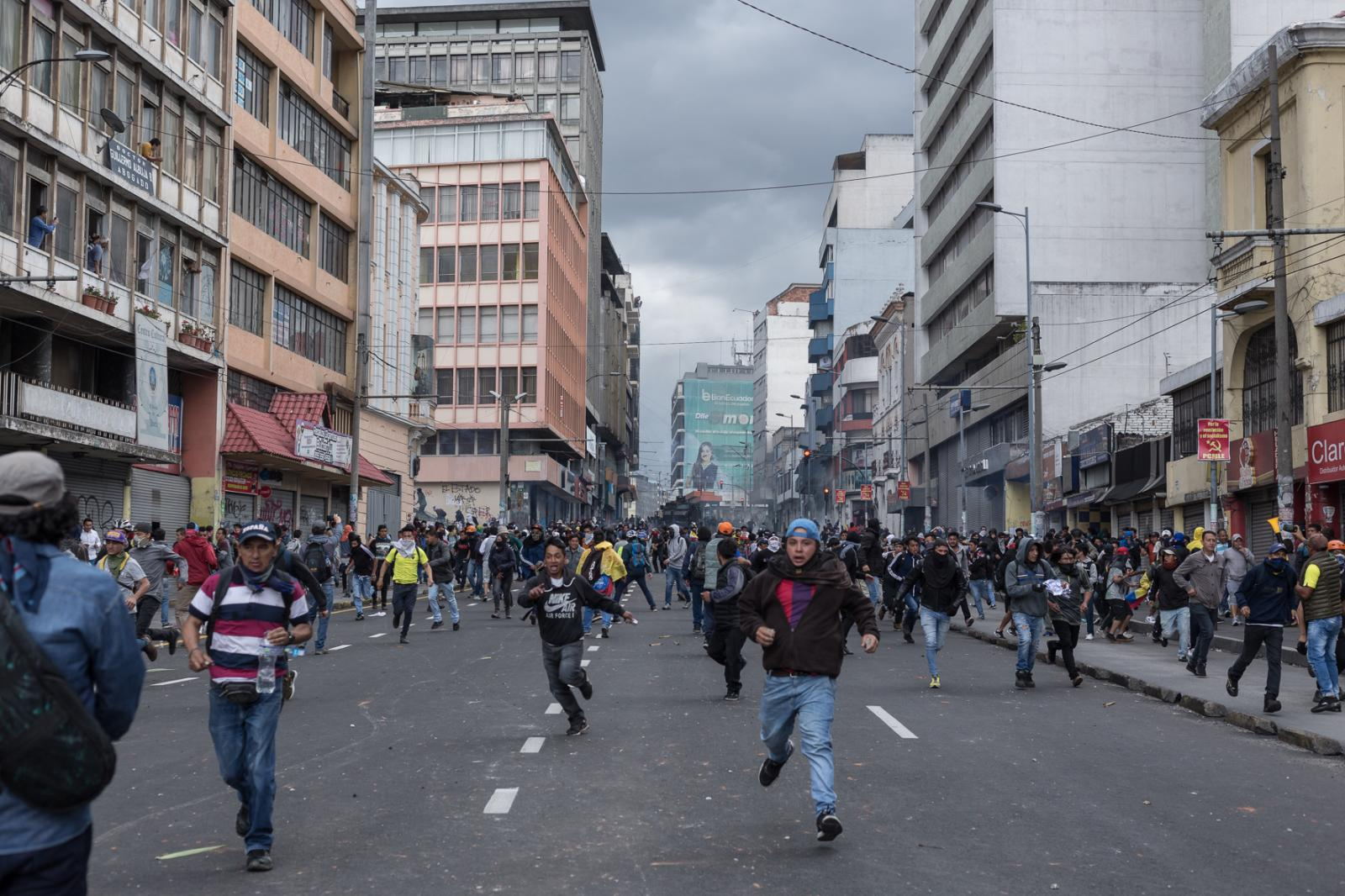 Demonstrators run along 10 de Agosto Avenue on the afternoon of October 4, 2019, in response to the arrival of anti-riot squads of the national police. The social outburst of those weeks showed the new control mechanisms of the police force. Quito, Ecuador.