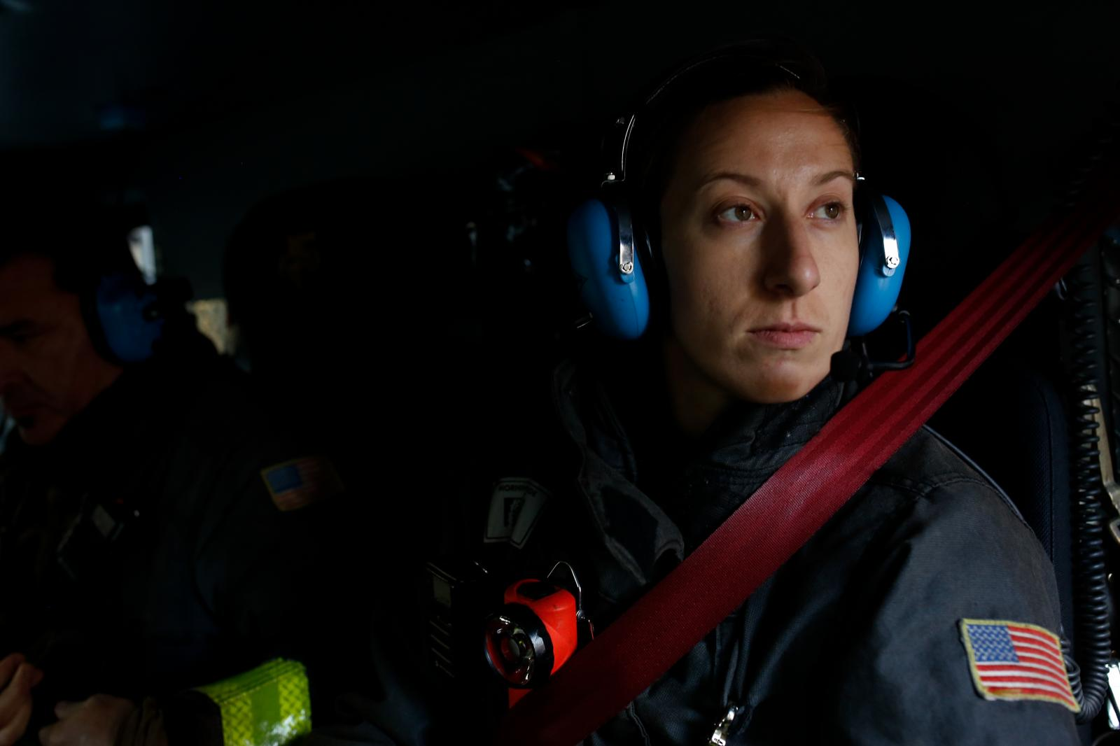 Alix Desmole remains calm as engine 13 speeds to building alarm in San Francisco.