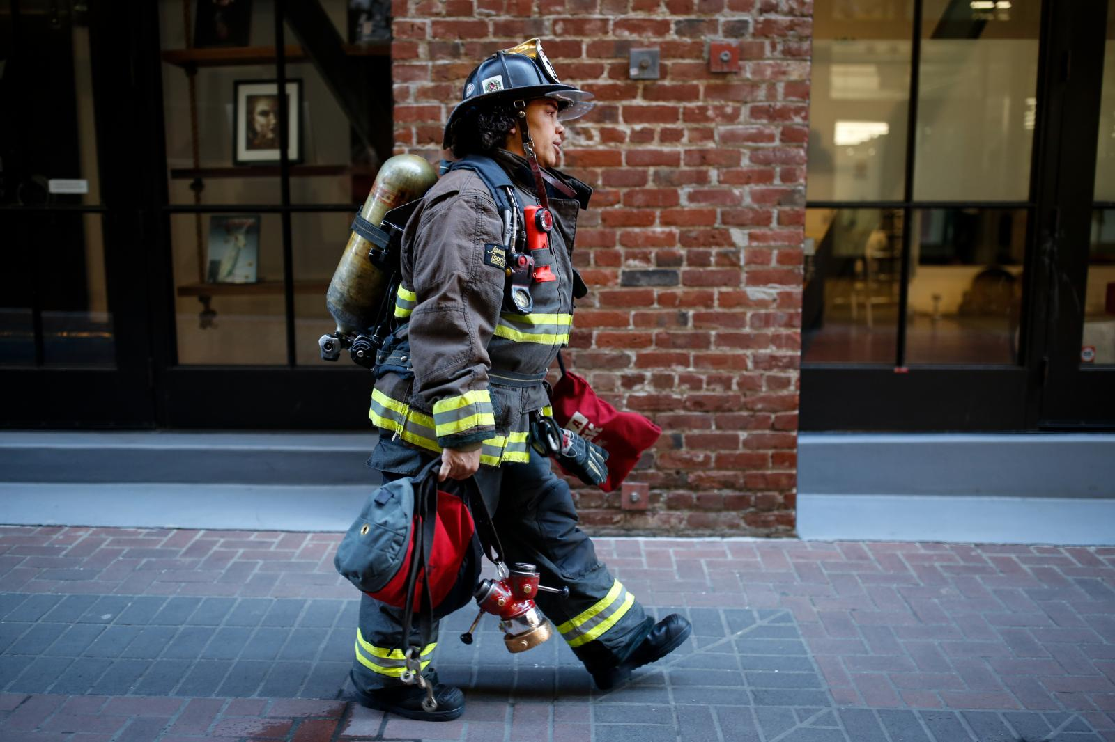 Lt. Julie DeJarlais walks back to the engine after determining a building alarm was accidentally triggered in downtown San Francisco.