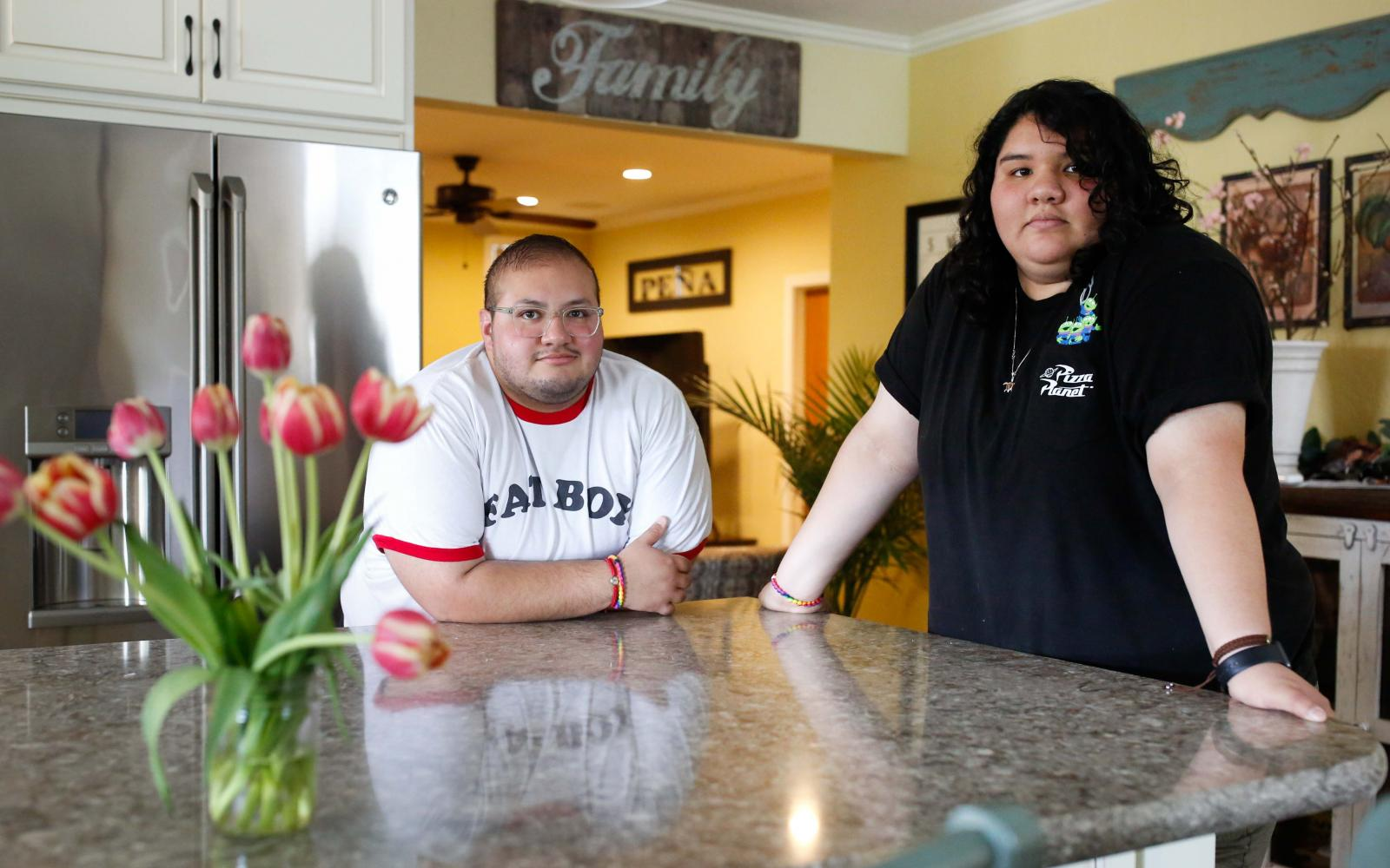 Frank Peña, 27, and sister Alejandra, 23, both live at home in their parent's house on Tuesday, May 14, 2019 in San Jose, Calif.