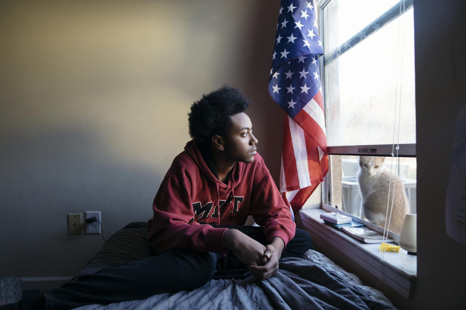 Nyjal Mitchell, 16, plays video games in his bed room in Opelousas, Louisiana.