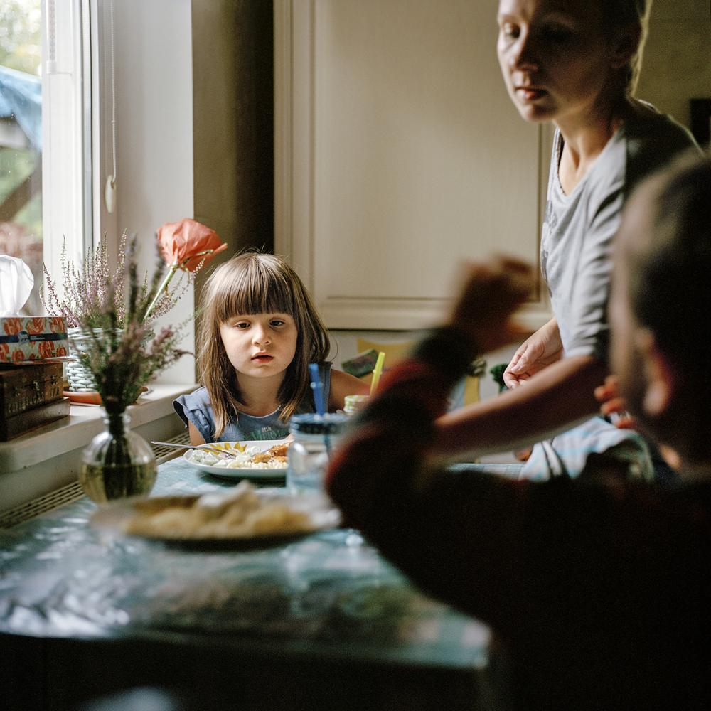 The Gembicki family at home. Kasia (Dżemil's wife) serves lunch to their children Lilia and Selim. Dżemil is a Muslim and Kasia is a Catholic. The conundrum that many mixed religion families face when choosing a faith for their children was easily solved: Lilia is brought up as Catholic and Selim as Muslim.
