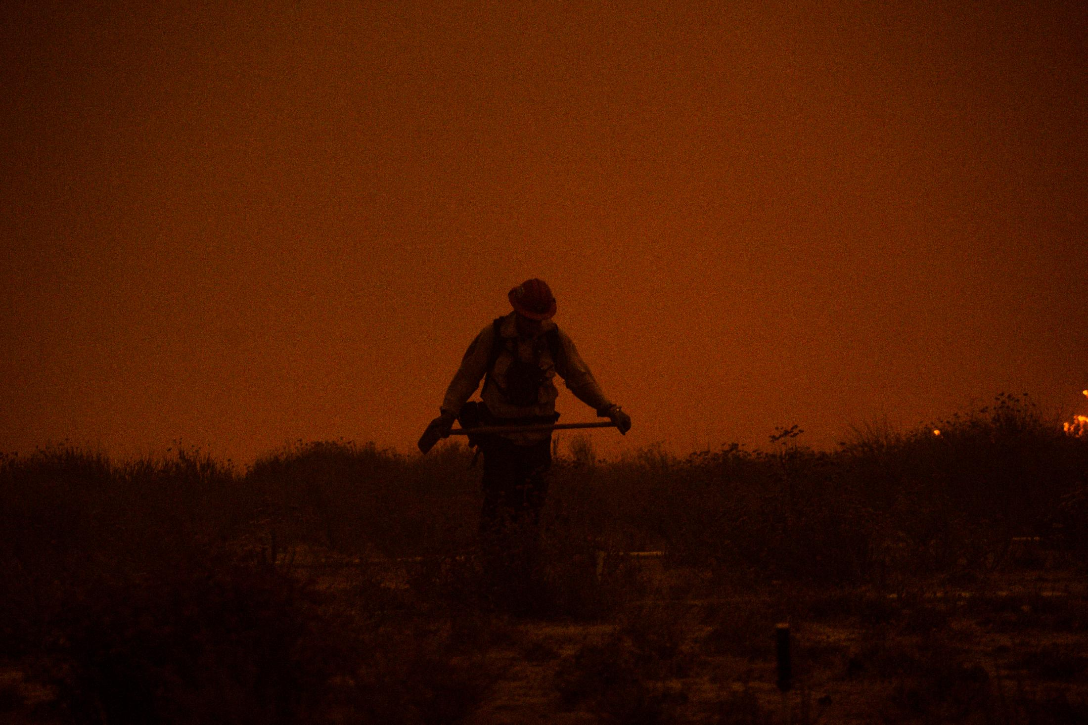 A CALFIRE member walks into the head of a deadly wildfire. This wildfire burned; 96,949 acres and destroyed 1,643 structures. Three people reported to have died in the blaze, and over a quarter-million evacuated.