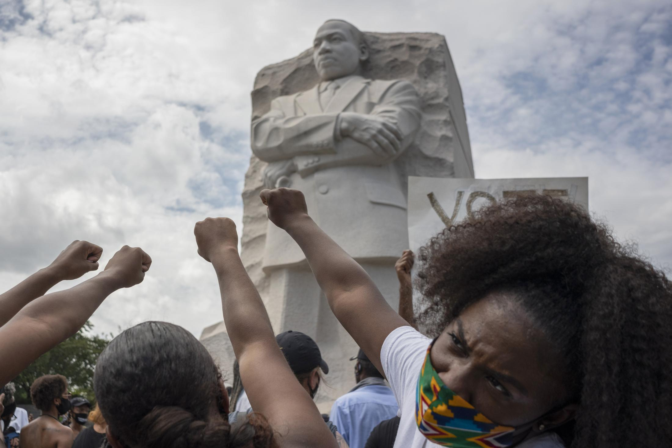 "Black women raise their fists in front of the MLK Memorial during the 57th annual March on Washington, Friday, August 28, 2020 in Washington, D.C. , Maryland. Also referred to as the ""Get Off Our Necks"" march, this year's march focused on the recent Black Lives Matter movement while commemorating the work of previous civil rights leaders."
