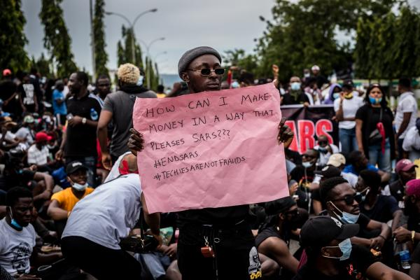 A protester holds up a placard during the #EndSARs protest in Abuja