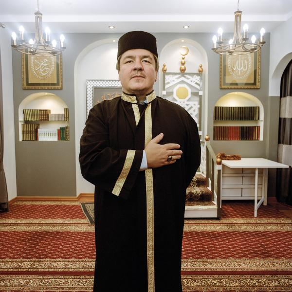 Mufti of Poland Tomasz Miśkiewicz in the prayer room of the Muslim Religious Association in Białystok. The title of Mufti is given to an educated Muslim who is qualified to give advice on applications of religious law in all aspects of everyday life. Miśkiewicz, a Polish Tatar from Podlasie, is the second Mufti in the history of Poland holding his office since 2004. The first Polish Mufti Jakub Szynkiewicz (also a Lipka Tatar) took the title in 1925. Szynkiewicz lived in exile from 1945 and died in the USA in 1966.