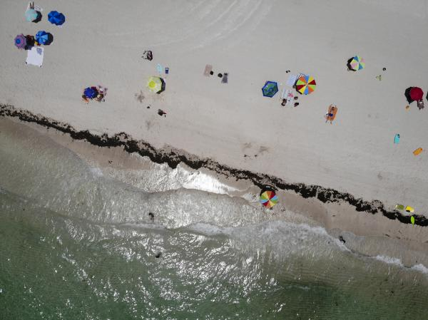FLORIDA, USA - JUNE 10: An aerial drone view of the beach as Miami reopens beaches after measures against the novel coronavirus (COVID-19) began to be lifted in Miami Beach, Florida, United States on June 10, 2020.