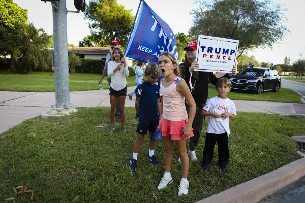 Supporters of President Donald Trump rally in front of poll station at Coral Gable Branch Public Library in Miami, Florida on November 3, 2020. Eva Marie UZCATEGUI