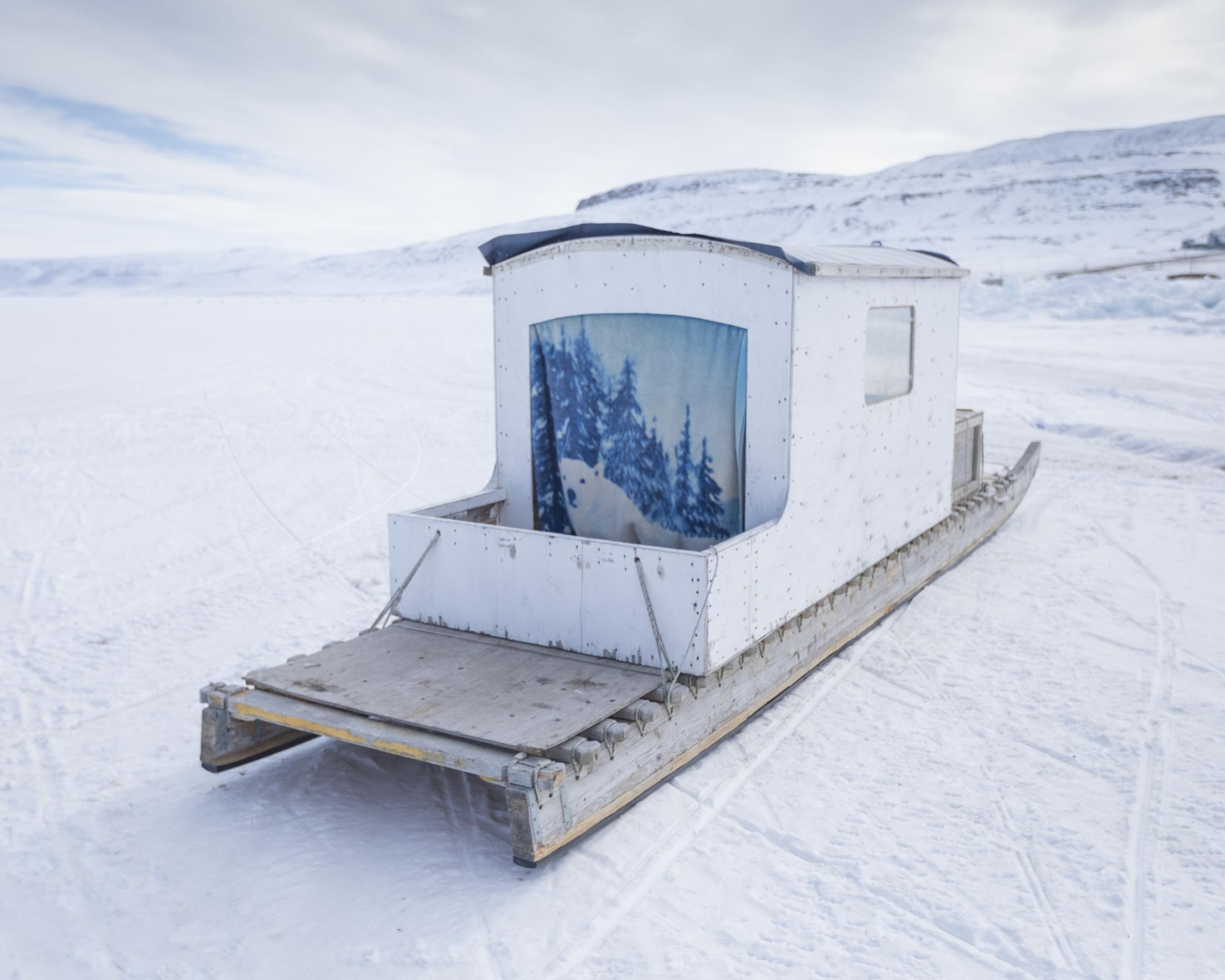 A qamutik, or homemade sled, is prepared for a long snowmobile journey in Arctic Bay, Nunavut.