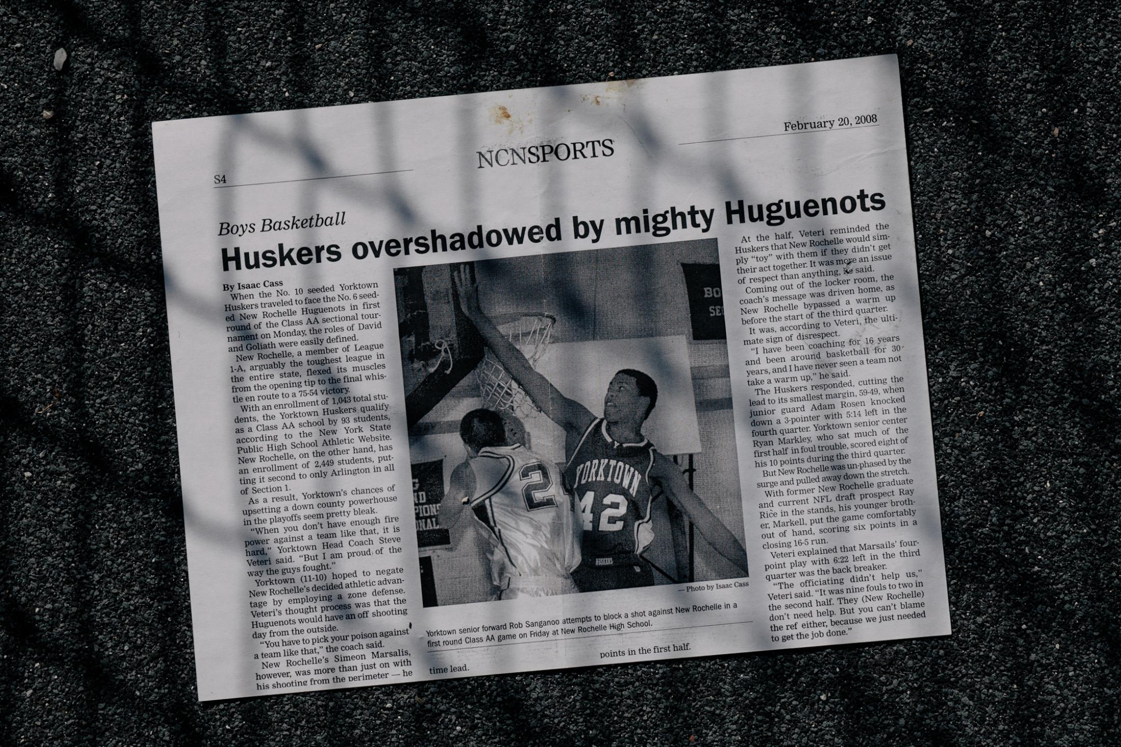An article from a local newspaper published months before Robert was diagnosed with Relapsing-Remitting Multiple Sclerosis displays Robert playing basketball for his high school basketball.